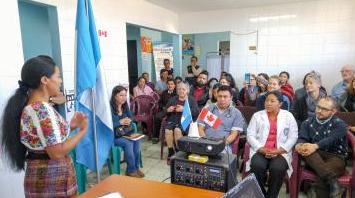 A nurse talks to the Canadian exchange participants