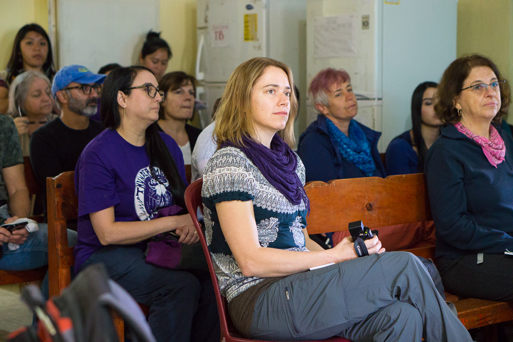 Leann Cunningham [center] and group members take in a presentation at the Santa María Chiquimula Health Centre