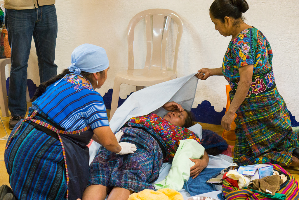 Traditional, Indigenous midwives perform a birth simulation, using equipment provided through Horizons and PIES de Occidente's MNCH project with support from the Government of Canada