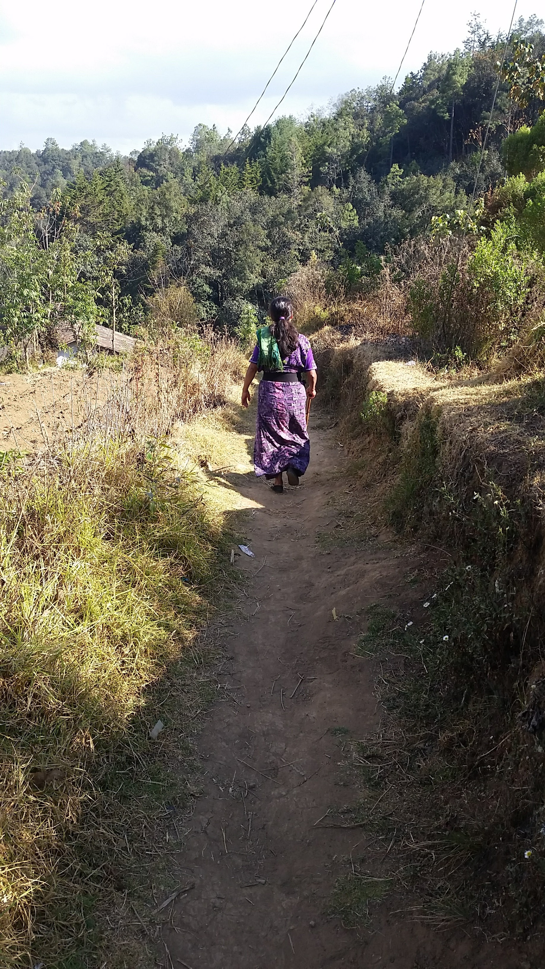 A midwife walking the path she takes to reach her patients in the rural highlands of Guatemala.