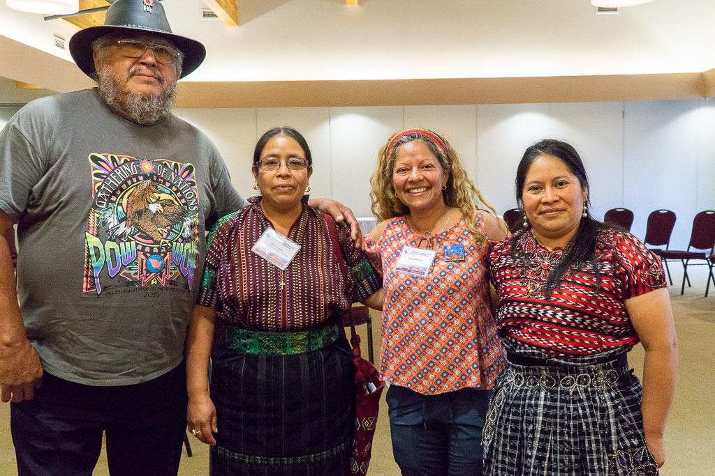 (From left to right)G'MIWON OTCHITCHAKONS aka Raymond Jackson, Antonia Buch, Diana Castaneda, and Verónica Mazariegos standing side-by-side in Manitoulin Island.