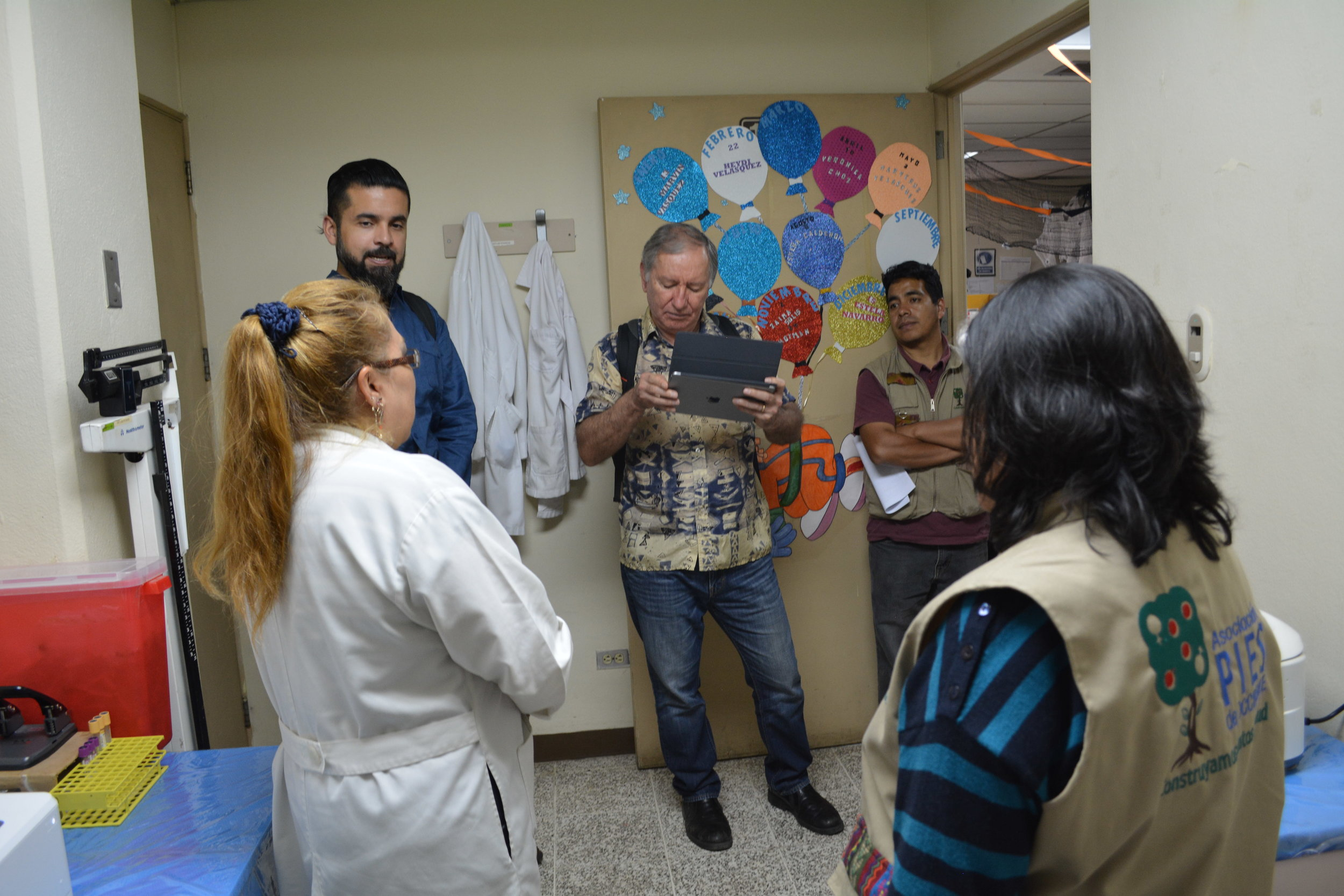 Veronica, René Guerra, Program Manage (center left), Sergio Quesada, Mesoamerican Program Financial Officer (Center), and PIES staff tour Totonicapán Hospital Laboratory.