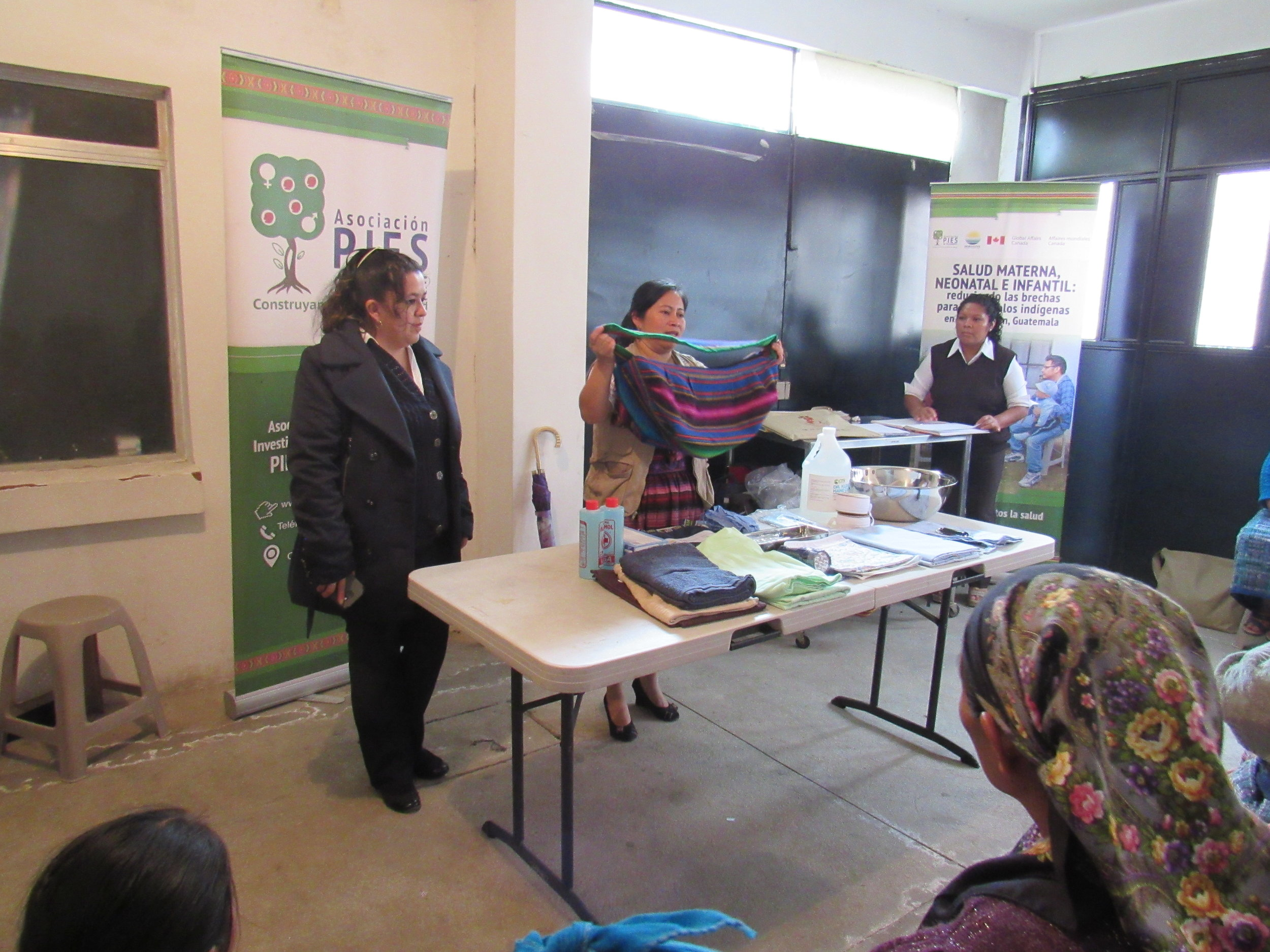 Lead trainers teach groups of midwifes how to use their equipment for safe, clean, deliveries.