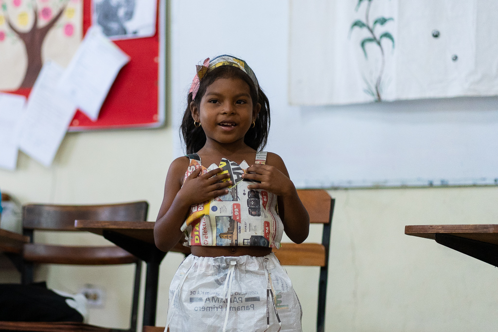 7-year old Alicia gave us a display of her 100% recycled dress that she made during her arts & crafts class with Madres Maestras.