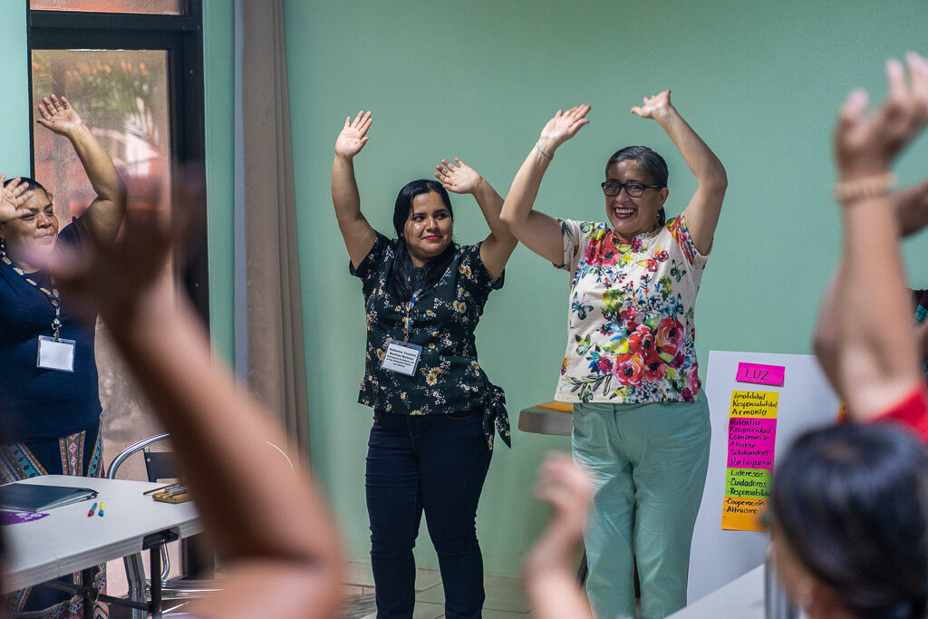 (left to right) Katherine Martinez and Cristina Alvarado from Visitacion Padilla, Women's Movement for Peace (Honduras) leading waking everyone up with an interactive dance!