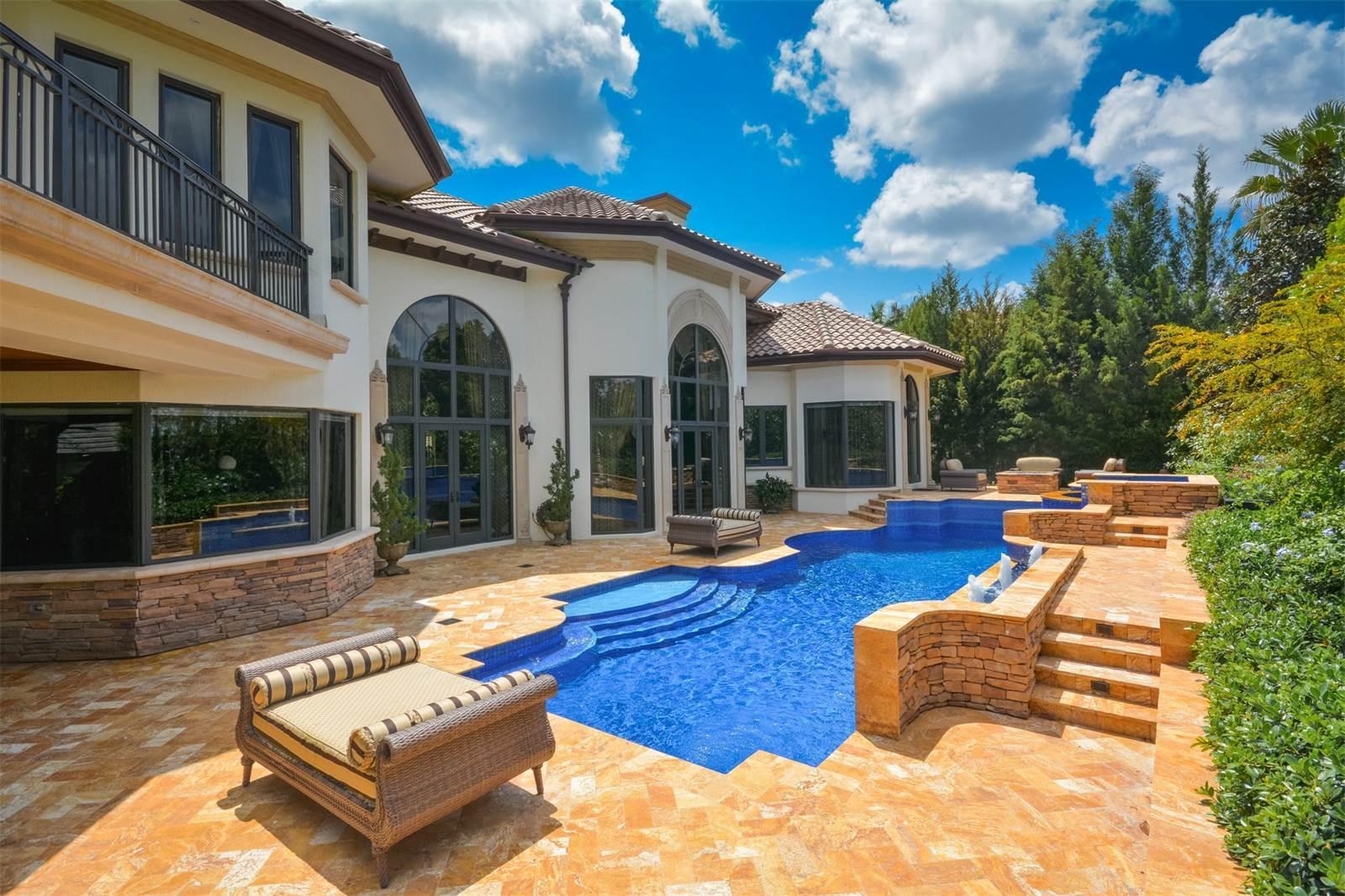 custom-backyard-beautiful-pool-tanning-entertaining.jpeg