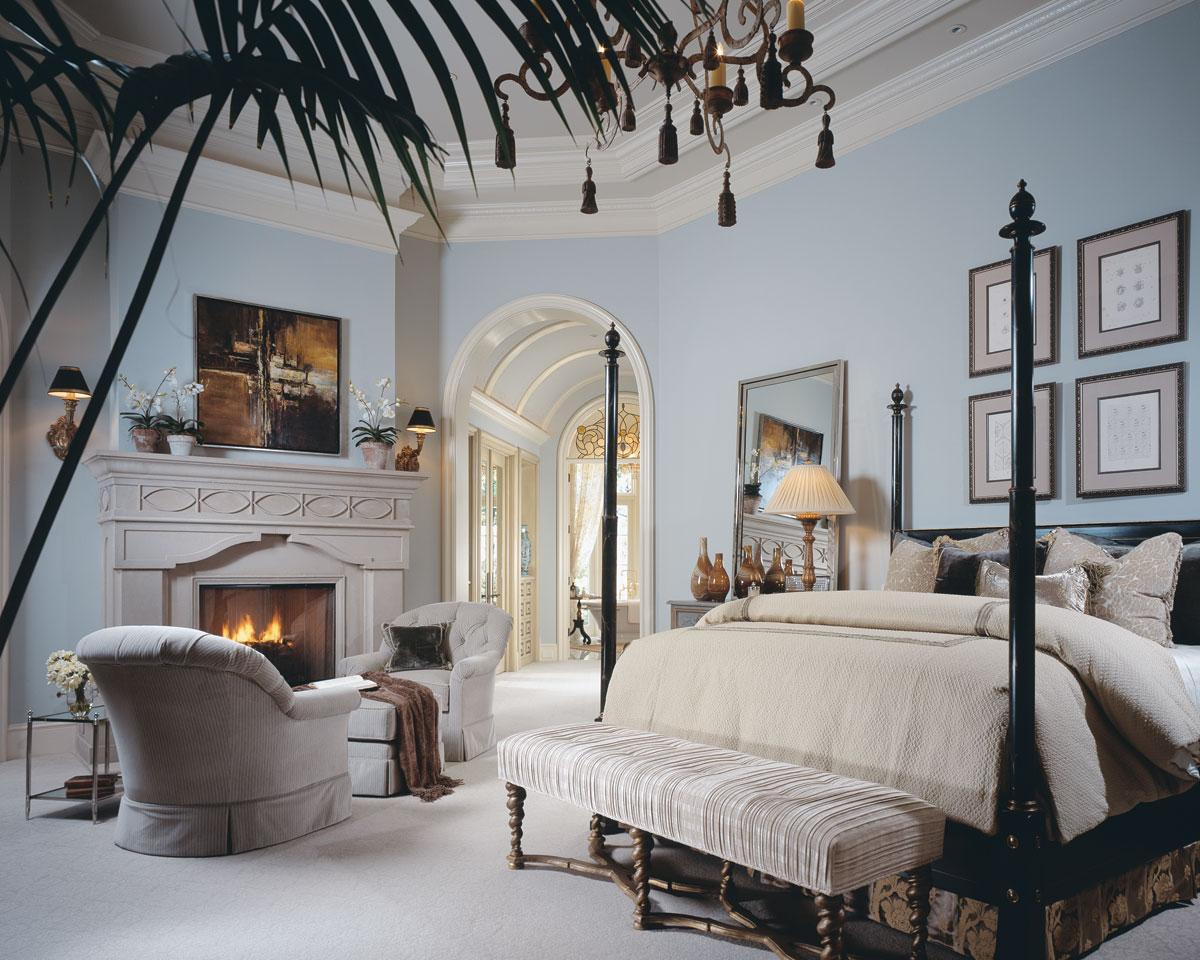 White crown molding elevates the already luxurious master suite.