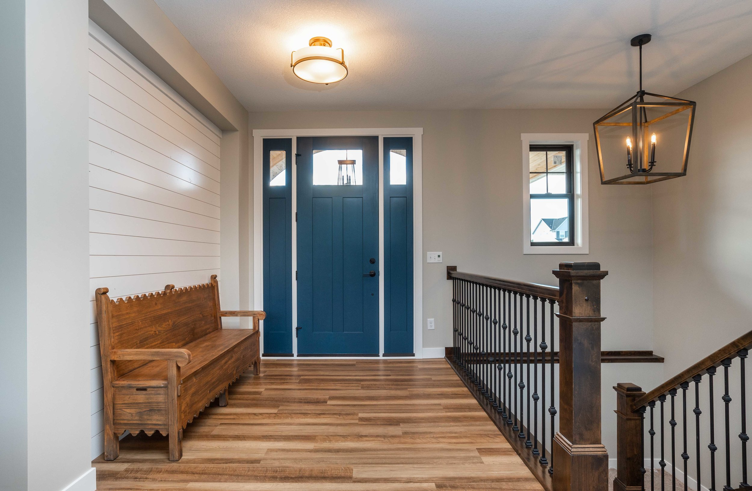 This beautiful blue door and ship lap wall make for a stunning entry way!