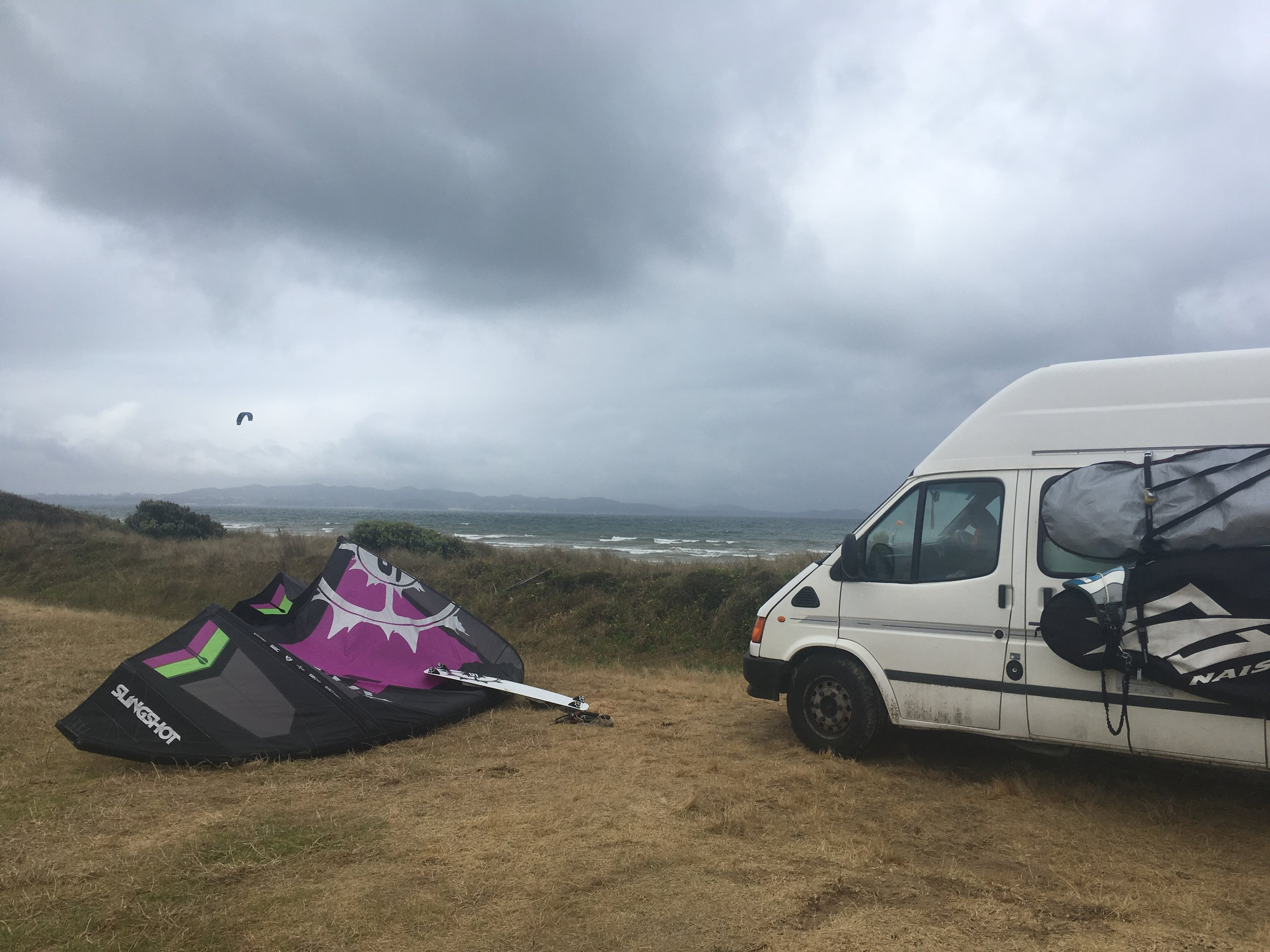 A windy day at Tokerau Beach. Got to love a camping spot where you can kite right in front of your van!