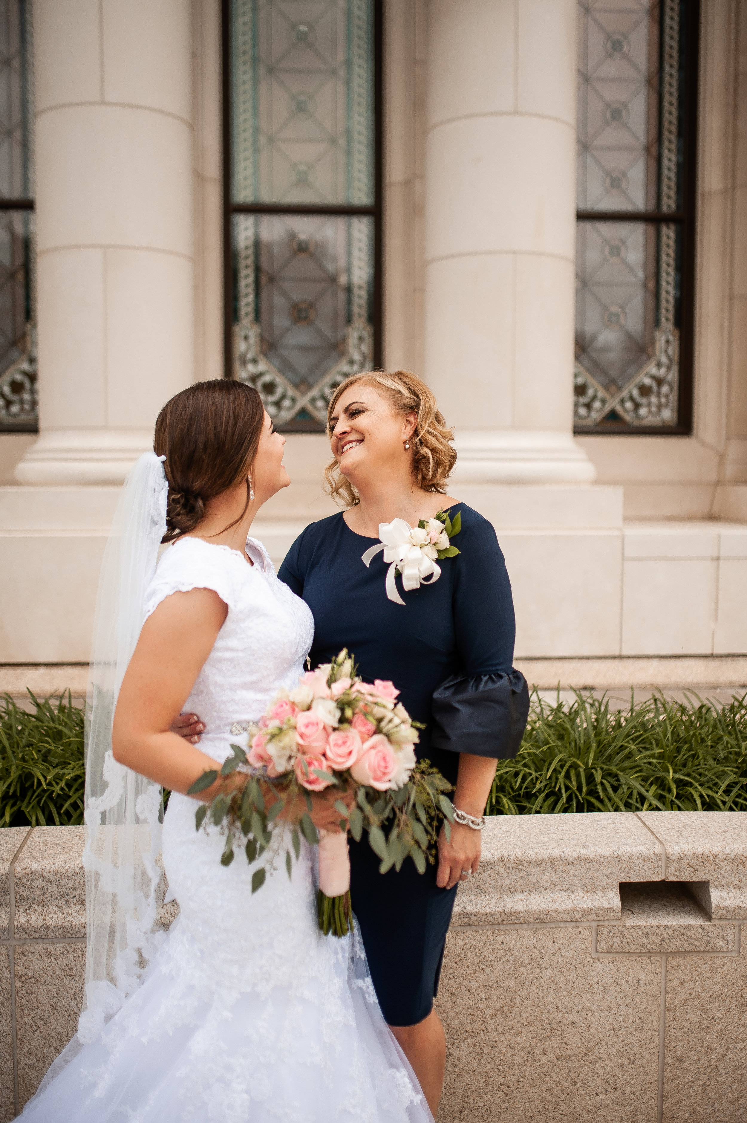 Bride & Mom sharing a sweet moment.