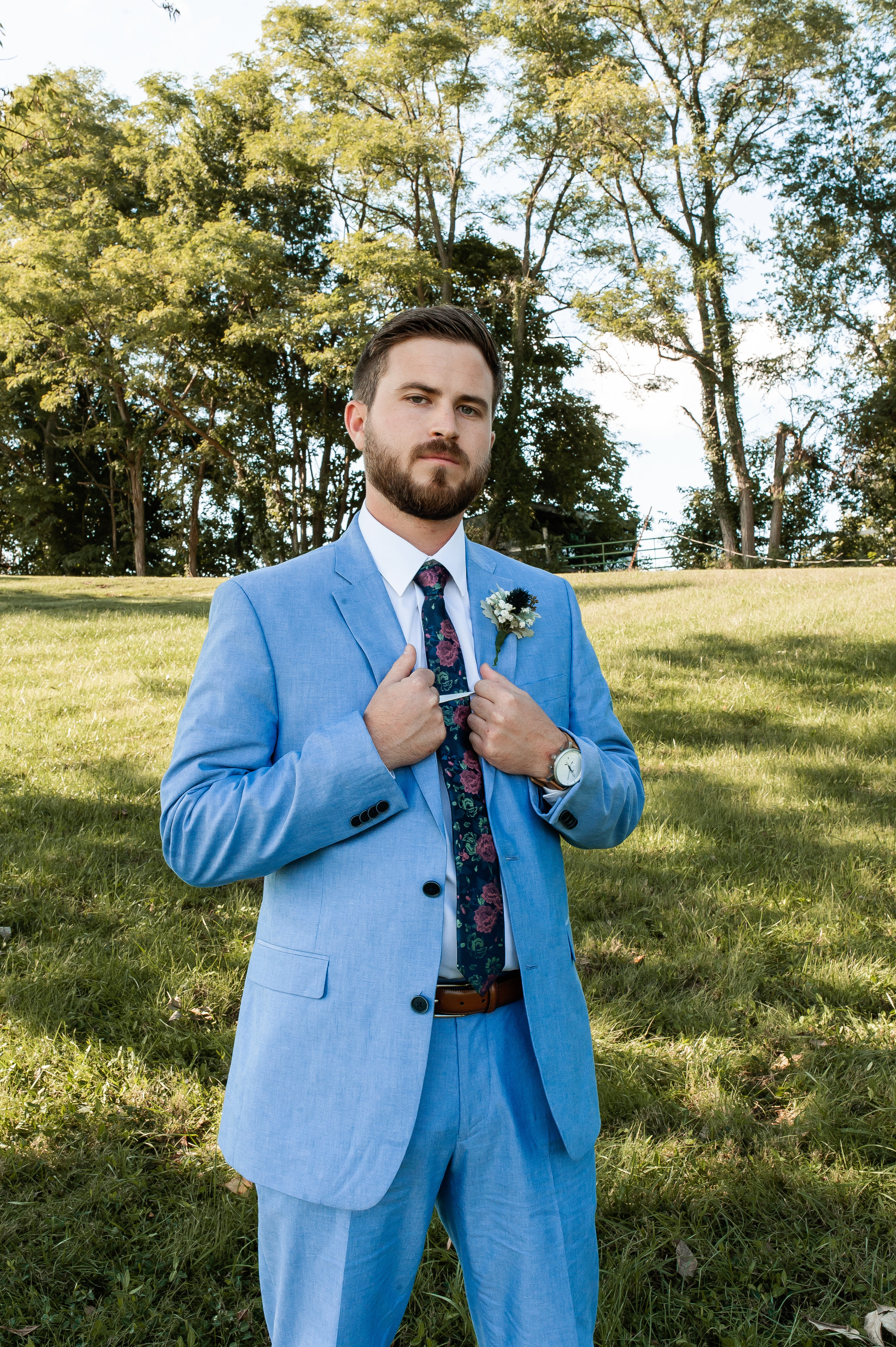 Chris looking dapper. Loved the unique floral tie and watch for his look.