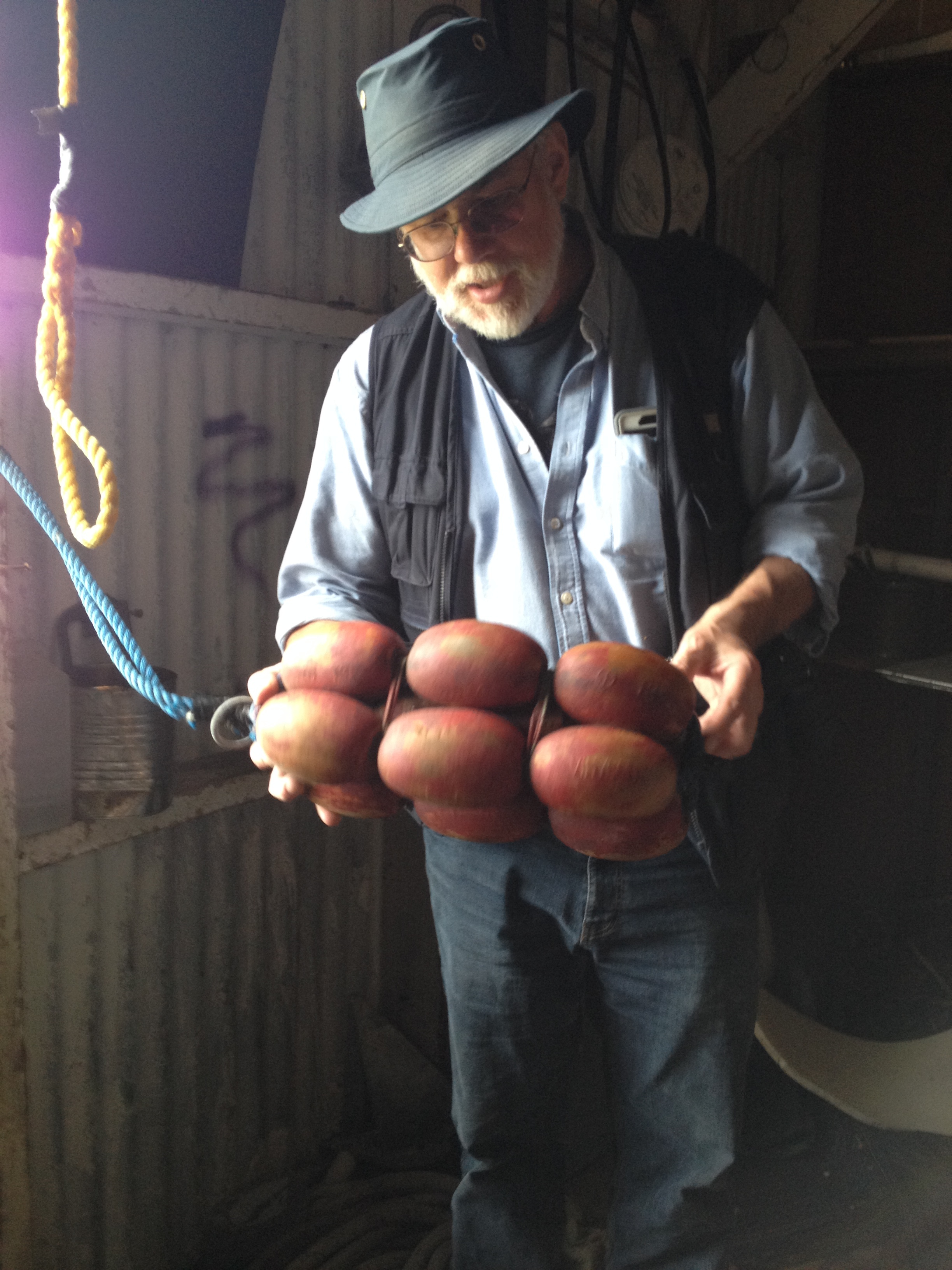 Bob King identifying an artifact in the net loft of the <NN> Cannery