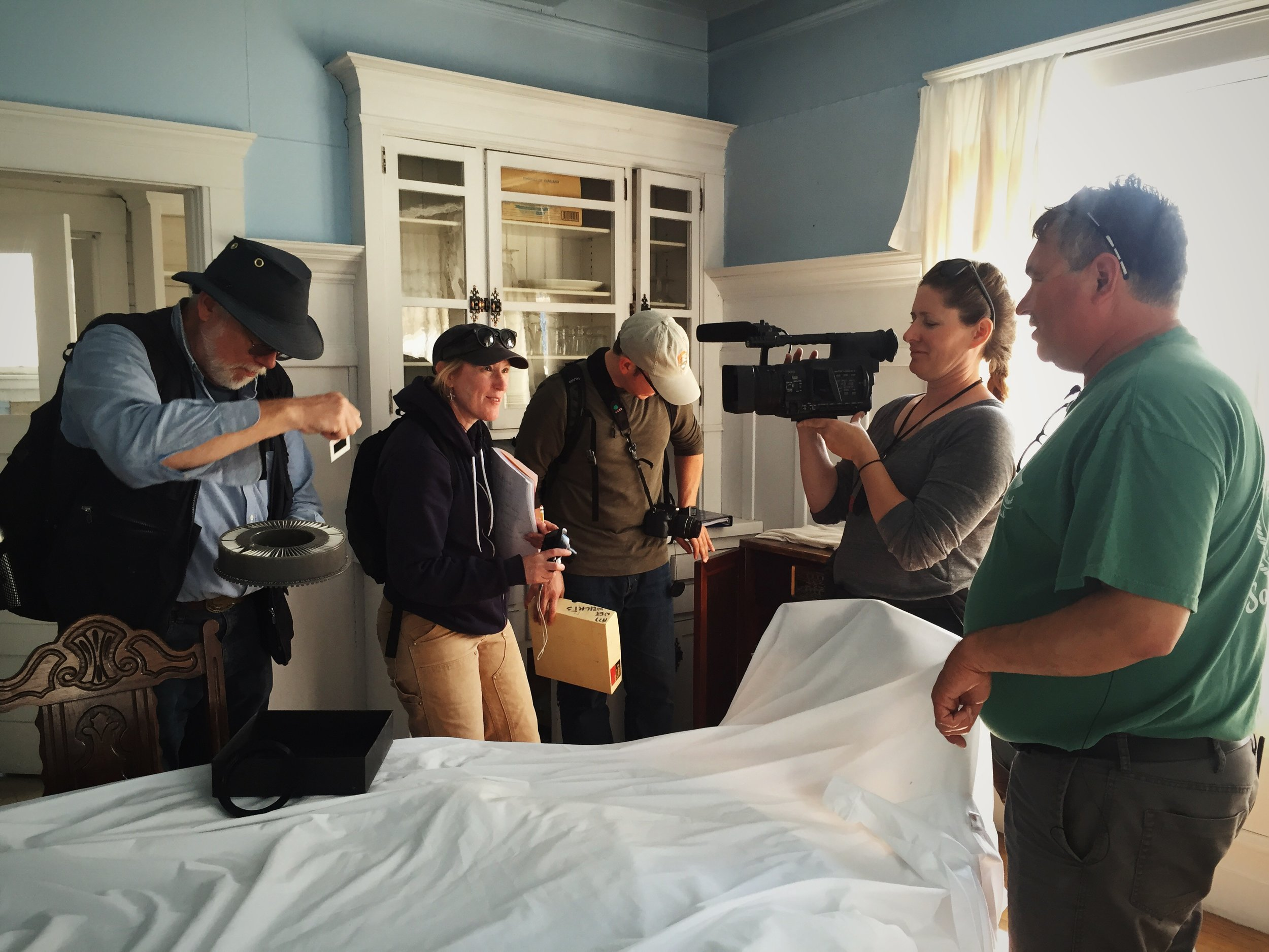 Historian Bob King, Historian Katie Ringsmuth, Title John Wachtel, Film Maker Sharon Thompson and Second Generation <NN> Cannery Watchman Carvel Zimin on site in the Superintendents White House during the collaborative effort to document the architecture of the campus in preparation for seeking a listing in the National Register of Historic Places.