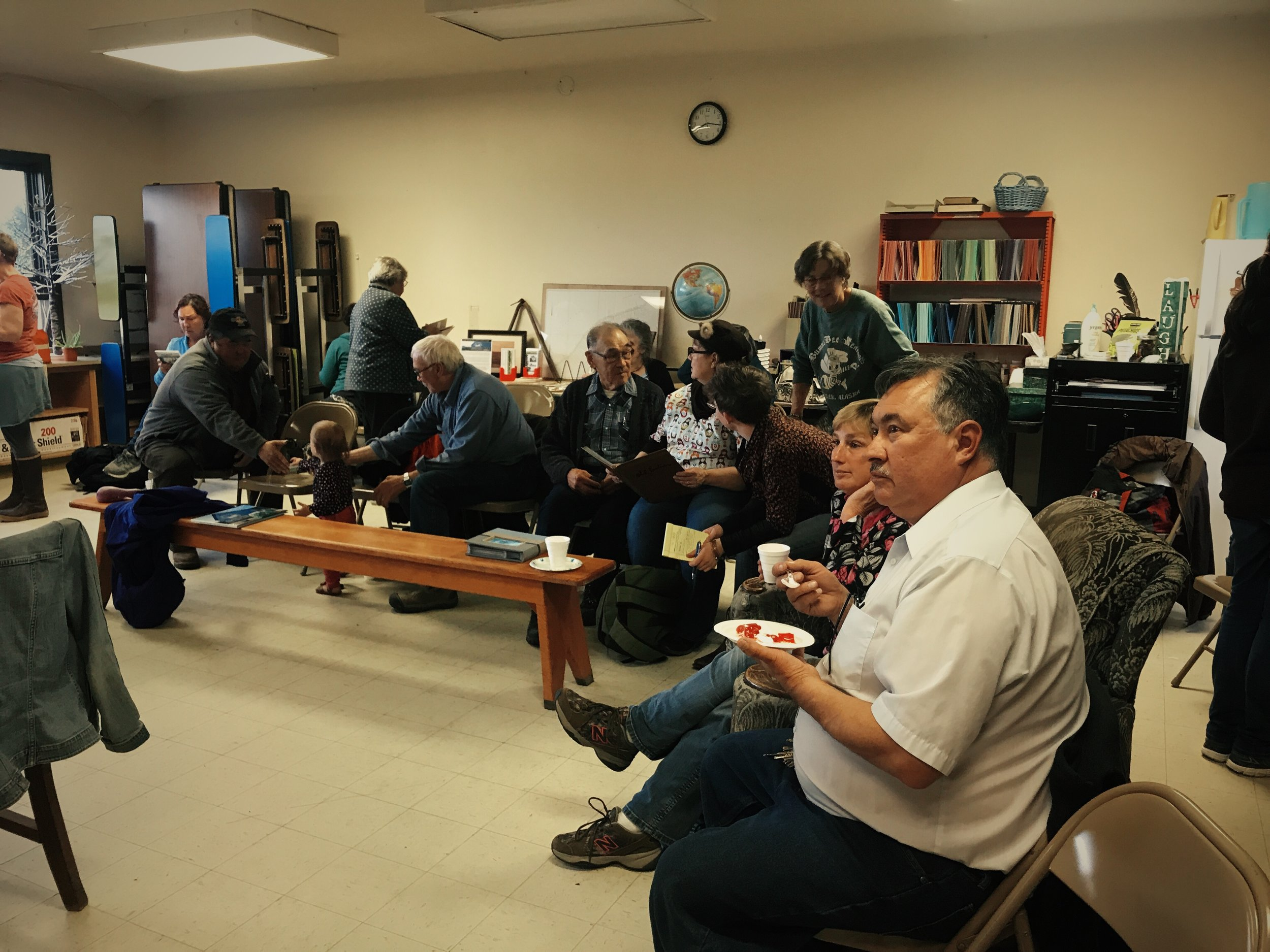 Carvel Zimin and other Bristol Bay residents learn about the NEH Creating Humanities Community grant during a presentation at the 2017 MugUp Conversations Event in South Naknek, AK