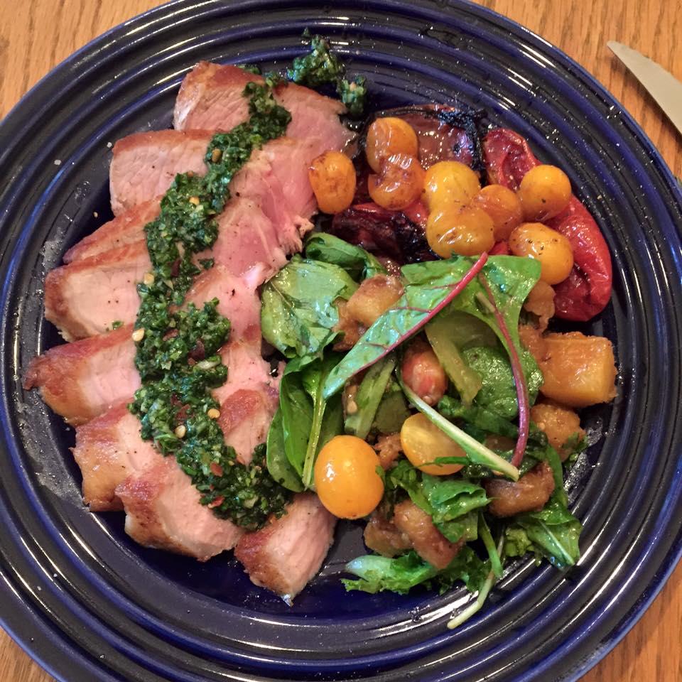 pork chops, basil chimichurri, acorn squash, charred tomatoes.jpg