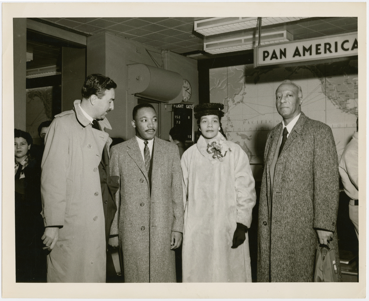 Dr. Martin Luther King, Jr. and his wife Coretta being greeted by Rev. Adam Clayton Powell, Jr. (left) and labor leader A. Philip Randolph (right) at the Pan American World Airways terminal, in New York City: Image: Schomburg Center for Research in Black Culture, Photographs and Prints Division, The New York Public Library. (1950 – 1959).