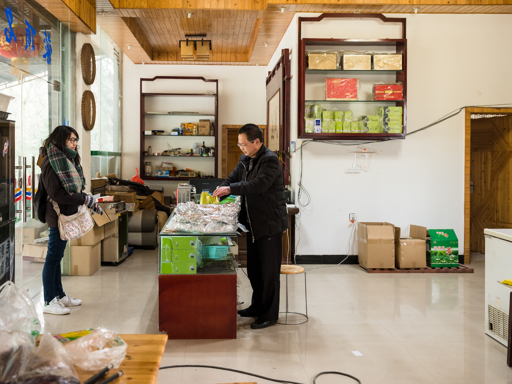 Nie packages our Gan Lu and Mao Feng tea for the long journey back to the Unite States, and ultimately to you!