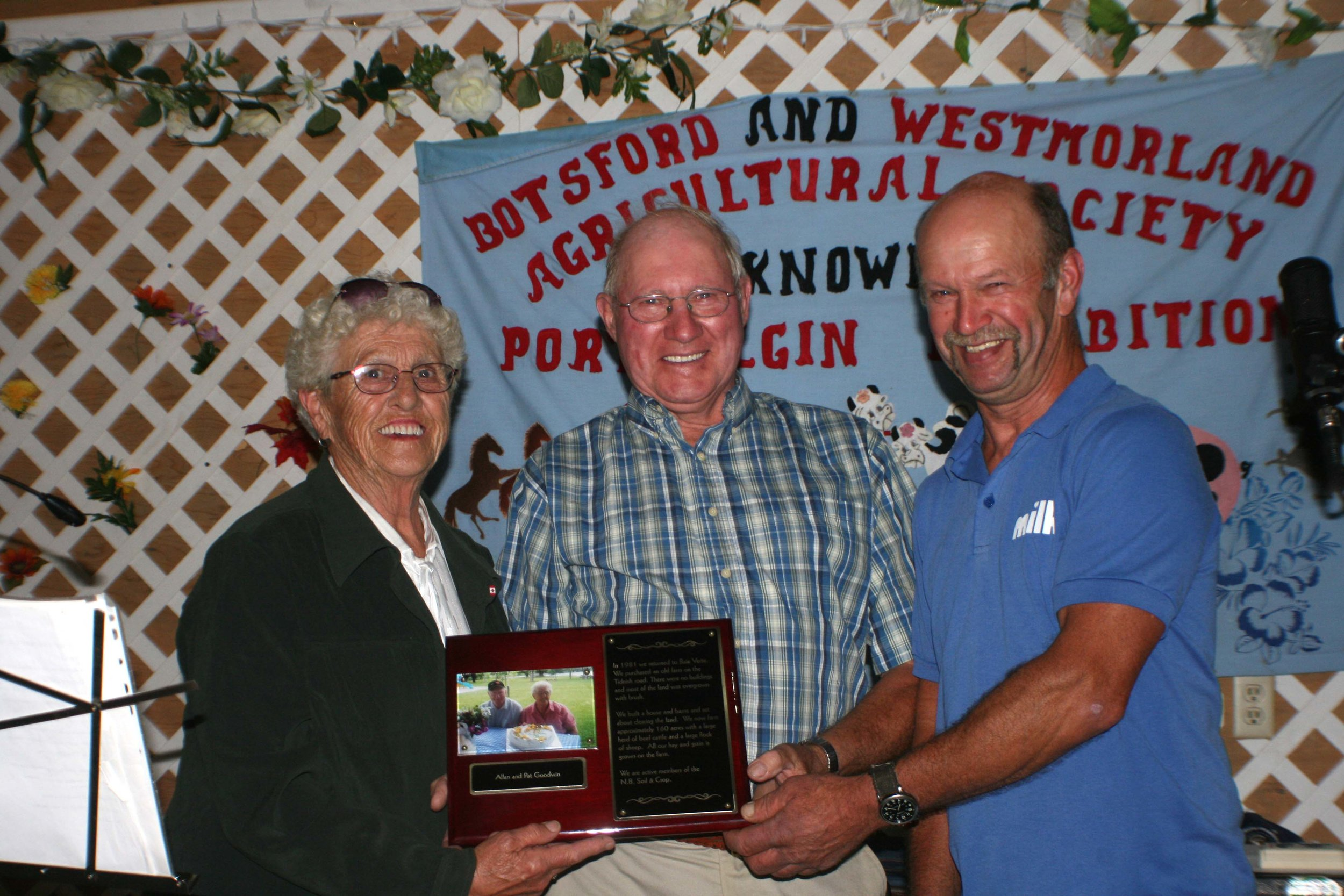 Allan and Patricia Goodwin of Baie Verte, N.B., were named farmers of the year during the 24th Port Elgin Exhibition, which was held Aug. 18-21. From left, Patricia and Allan Goodwin, and Con Rommens, a director of the Botsford and Westmorland Agricultural Society, which sponsors the exhibition. (Joan LeBlanc photo)