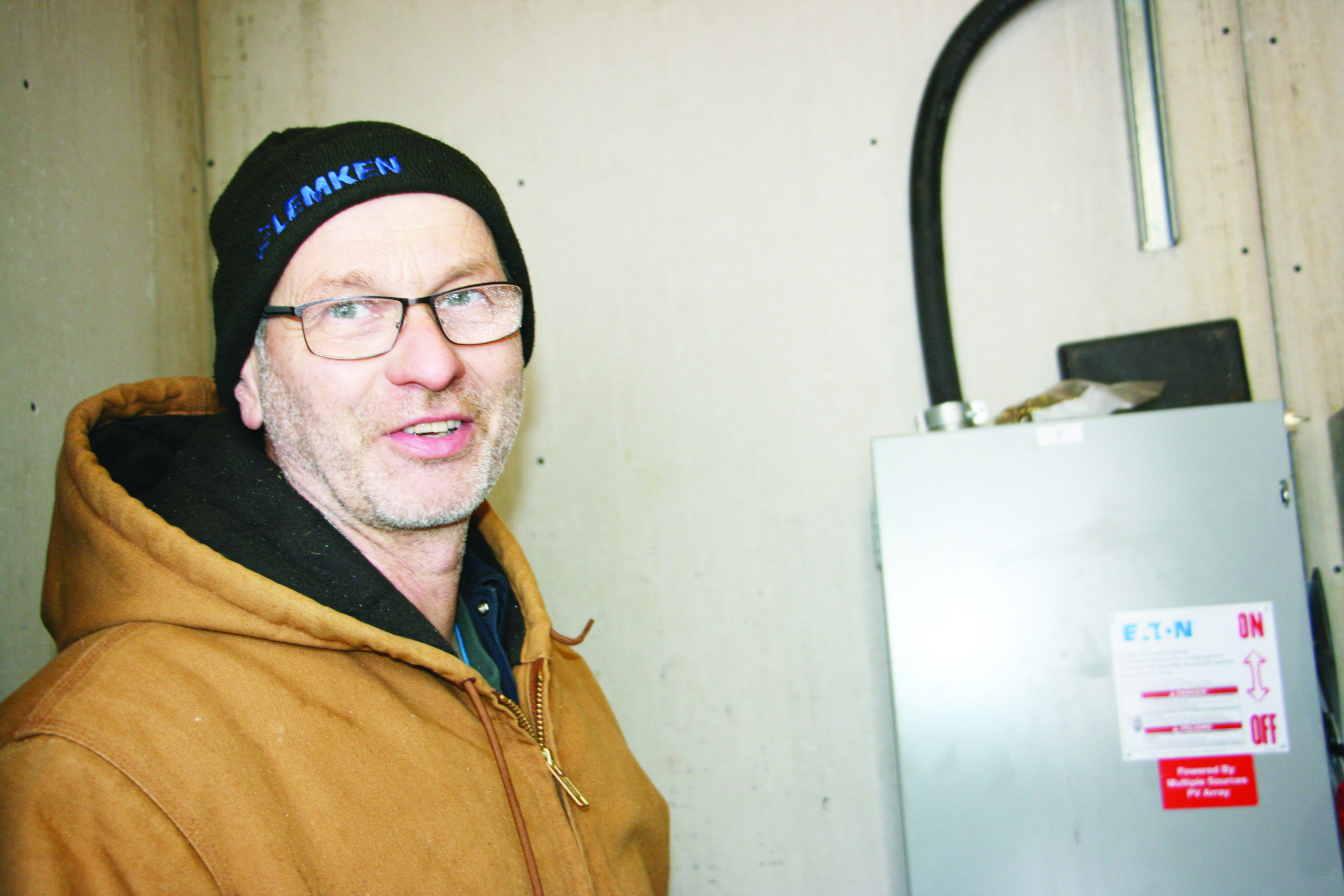 Frank Jopp of Auenland Farm in Mount Pisgah, N.B., began selling solar-generated electrical power to the New Brunswick grid in December. The collected power goes through a series of breaker panels. (George Fullerton photo)