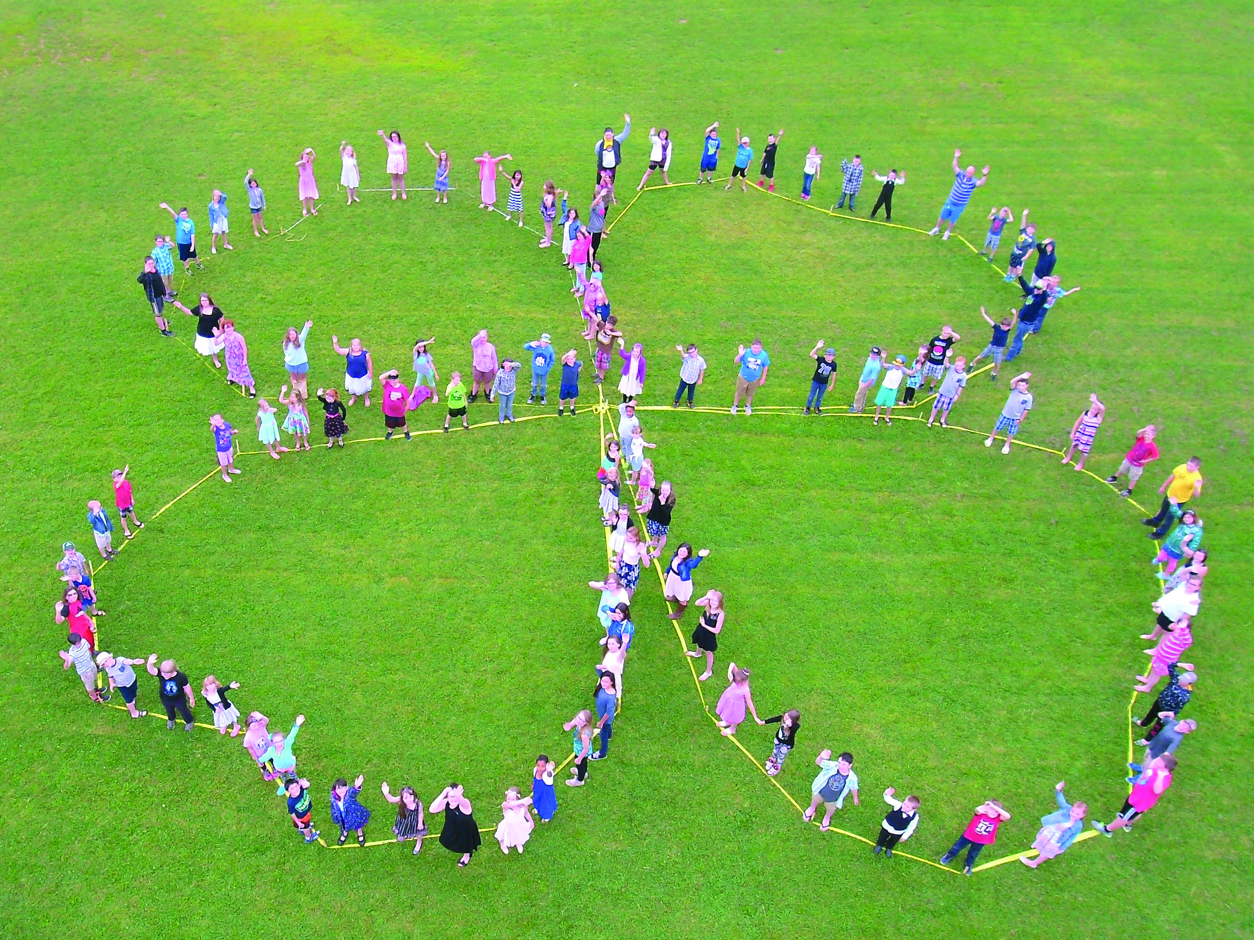 Students at a local elementary school helped Country View 4-H Club members form a giant human clover. (Submitted photo)