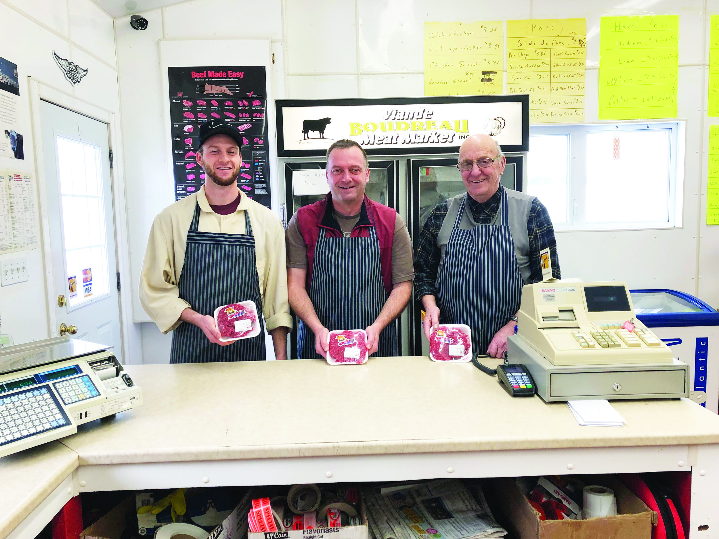 Three generations inside the Boudreau family's meat market, from left, Jocelyn, Guy, and Donald Boudreau. (Submitted photo)