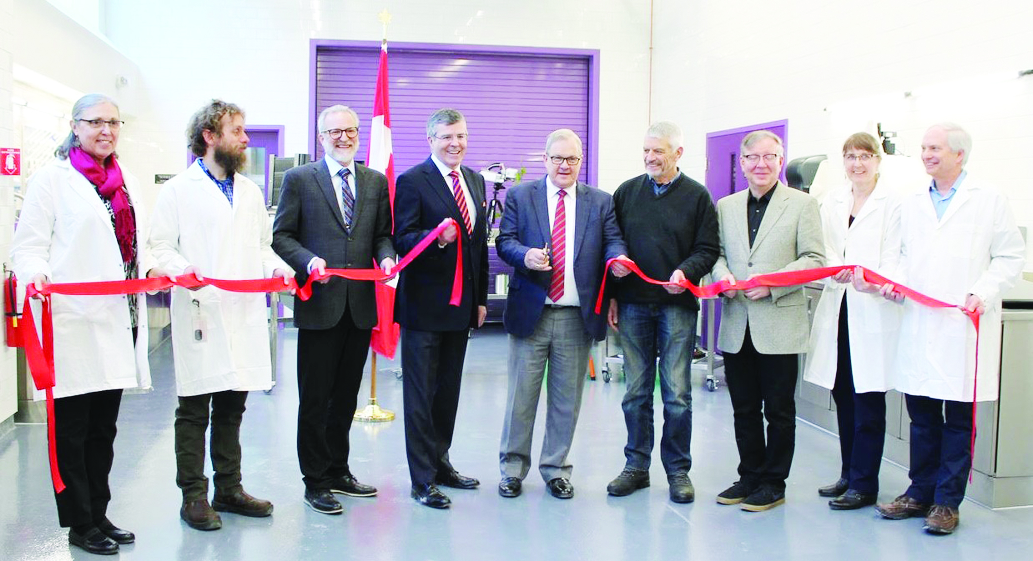 Lawrence MacAulay was in Nova Scotia's Annapolis Valley on Feb. 28, which turned out to be his last day as the federal agriculture minister before being shuffled into Veterans Affairs. MacAulay joined wine industry professionals, grape producers, and research scientists for the grand opening of the Kentville Research and Development Centre's new research winery facility. Pictured, from left, are Dr. Deb Moreau, Dr. Harrison Wright, Dr. Girard Benoit, Alex MacDonald, MacAulay, Bruce Wright, Dr. Mark Hodges, Dr. Shawna MacKinnon, and Dr. Charles Forney. (Emily Leeson photo)