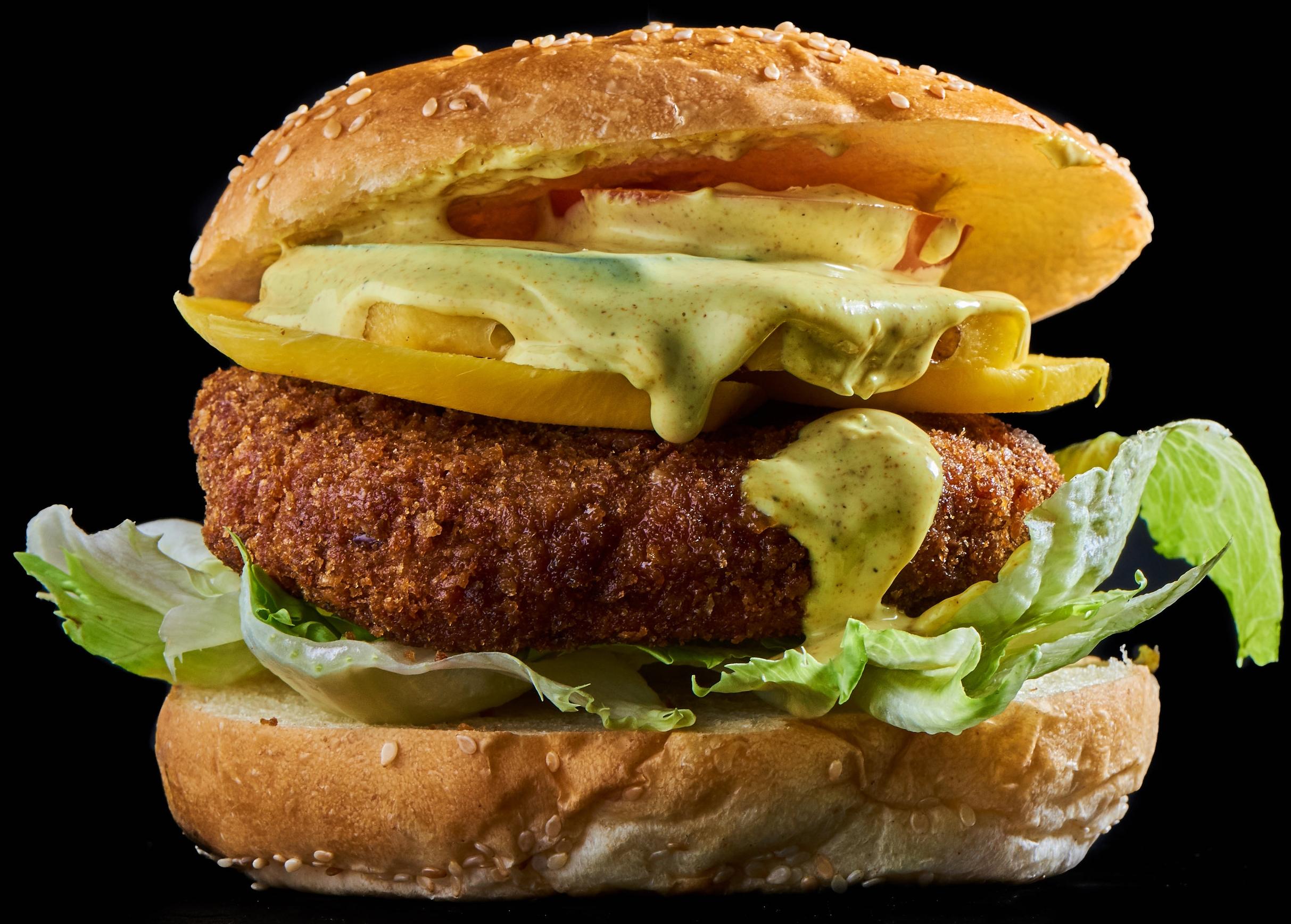 Bollywood Burger - mit grillierter Ananas, Mango, Curry-Mayo, Eisbergsalat, Salatgurke und Tomate15.70