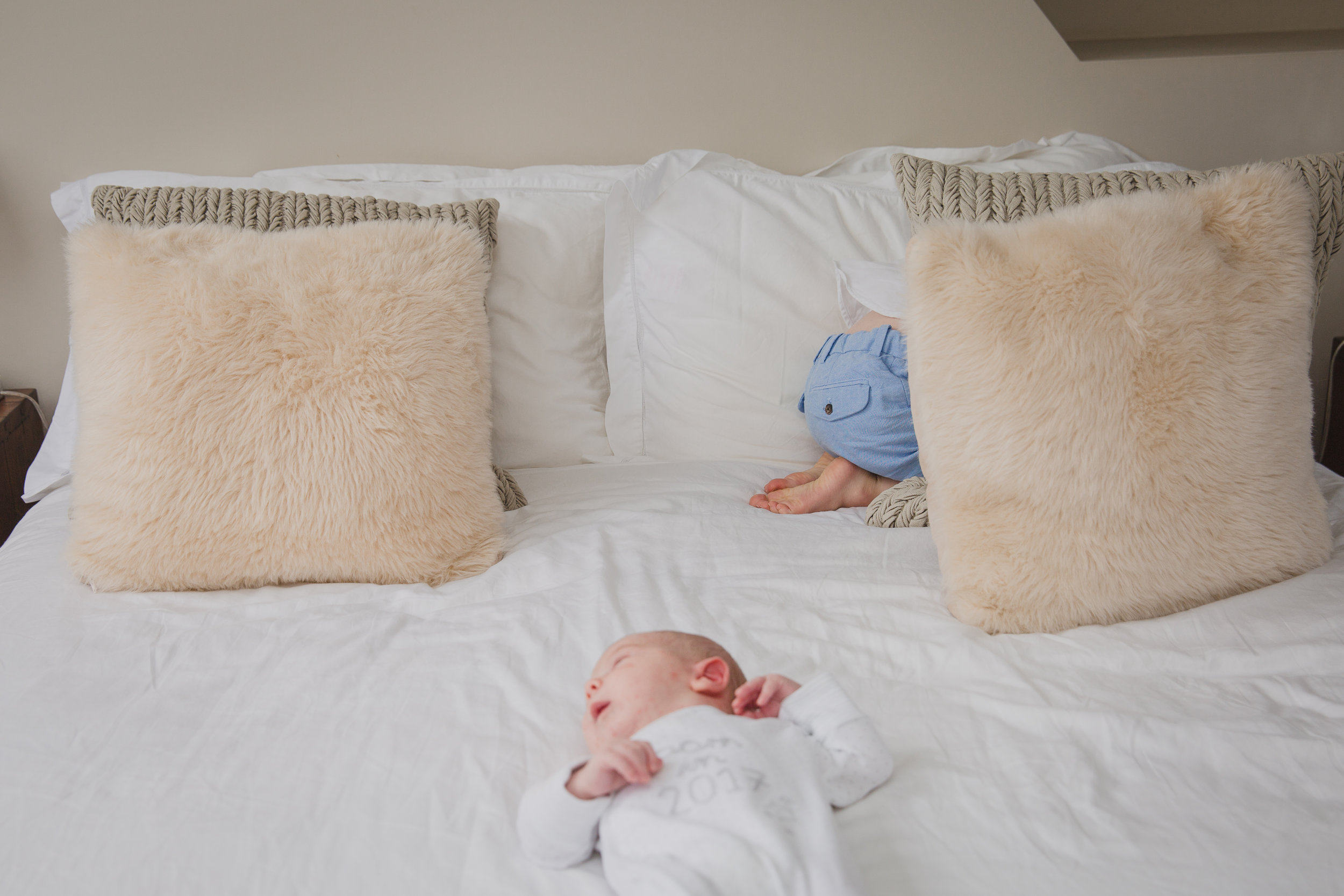 Toddler hiding from baby | Kirsty Hamilton Photography