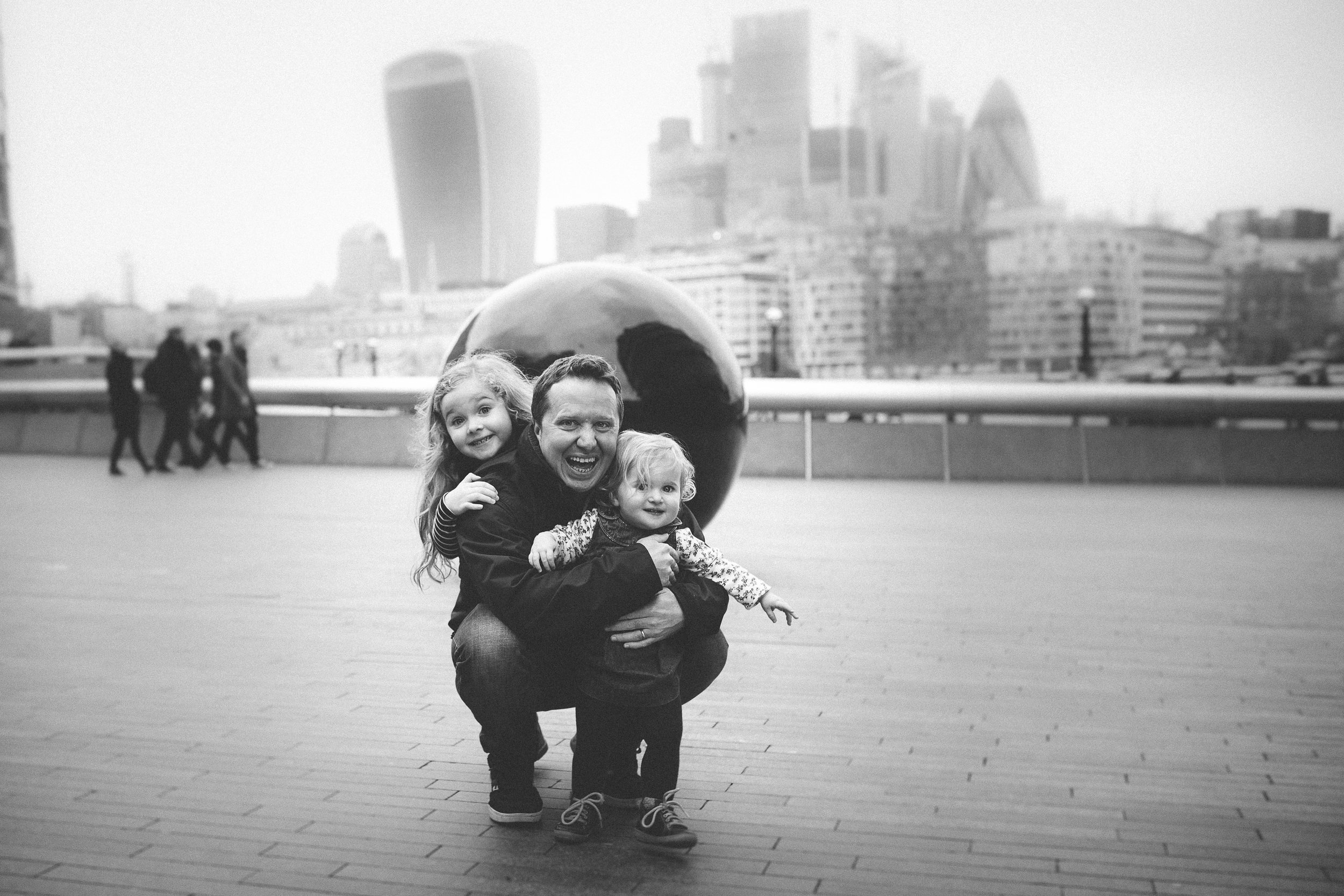 Dad and daughters in London City