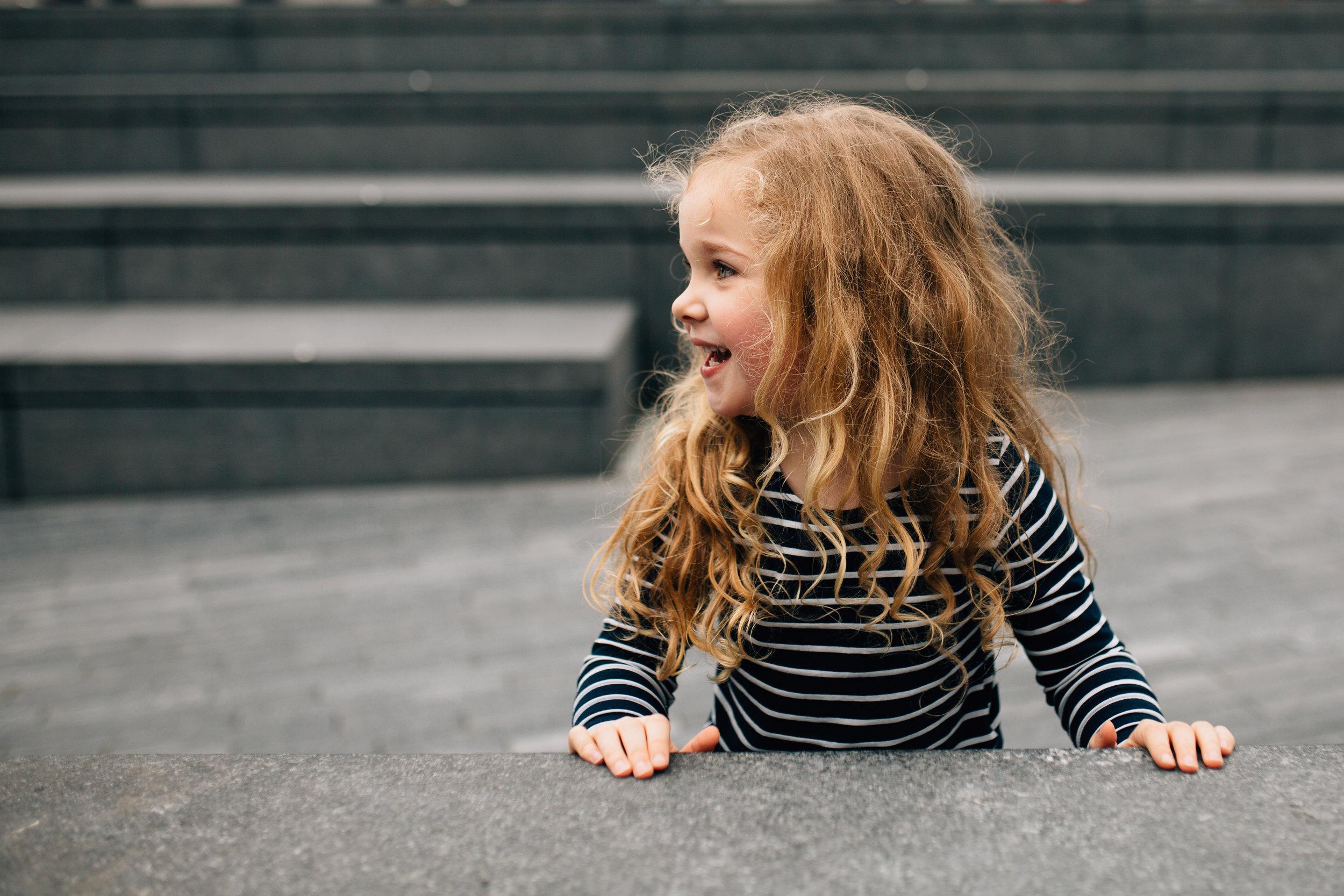 Girl outside City Hall River Thames London