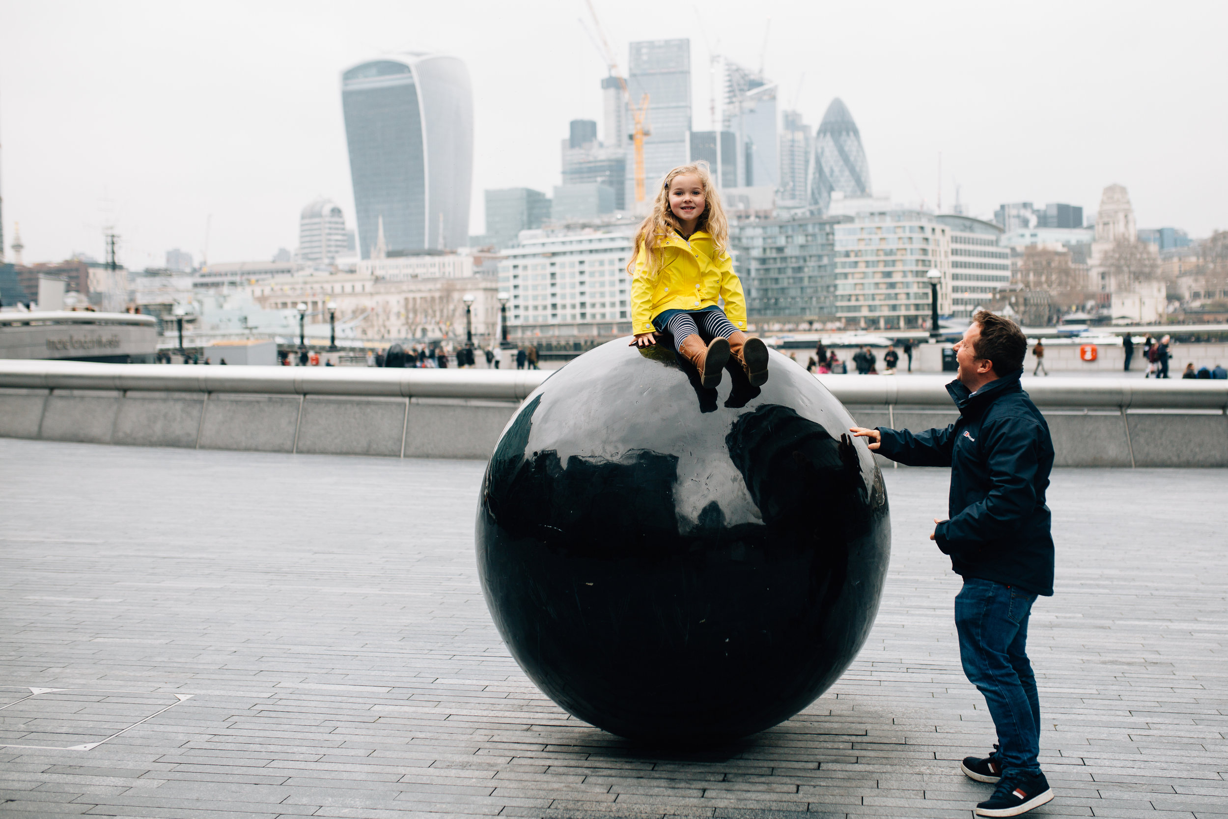 Girl on sculpture London City Photographer