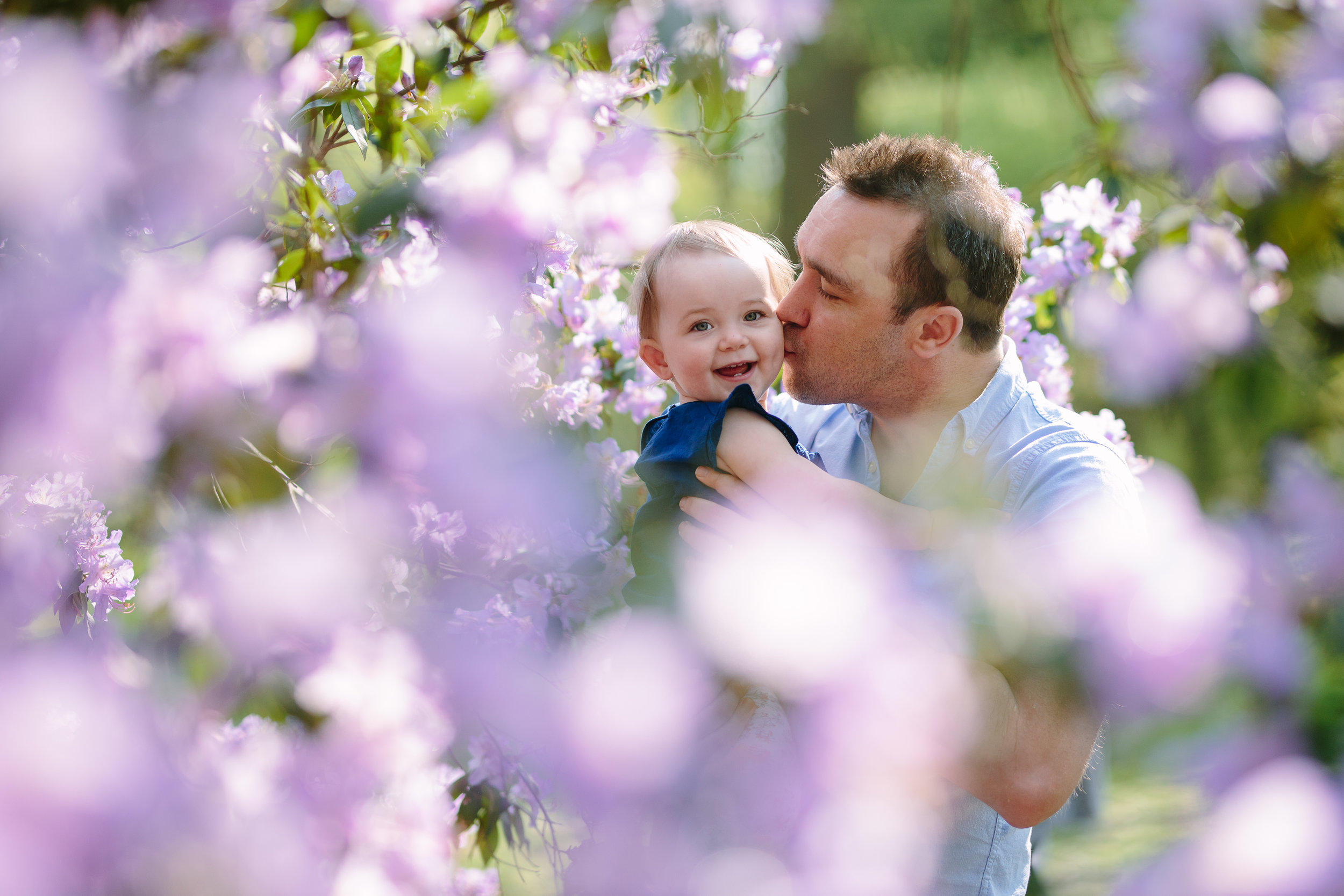 Dad and baby girl in the blossom
