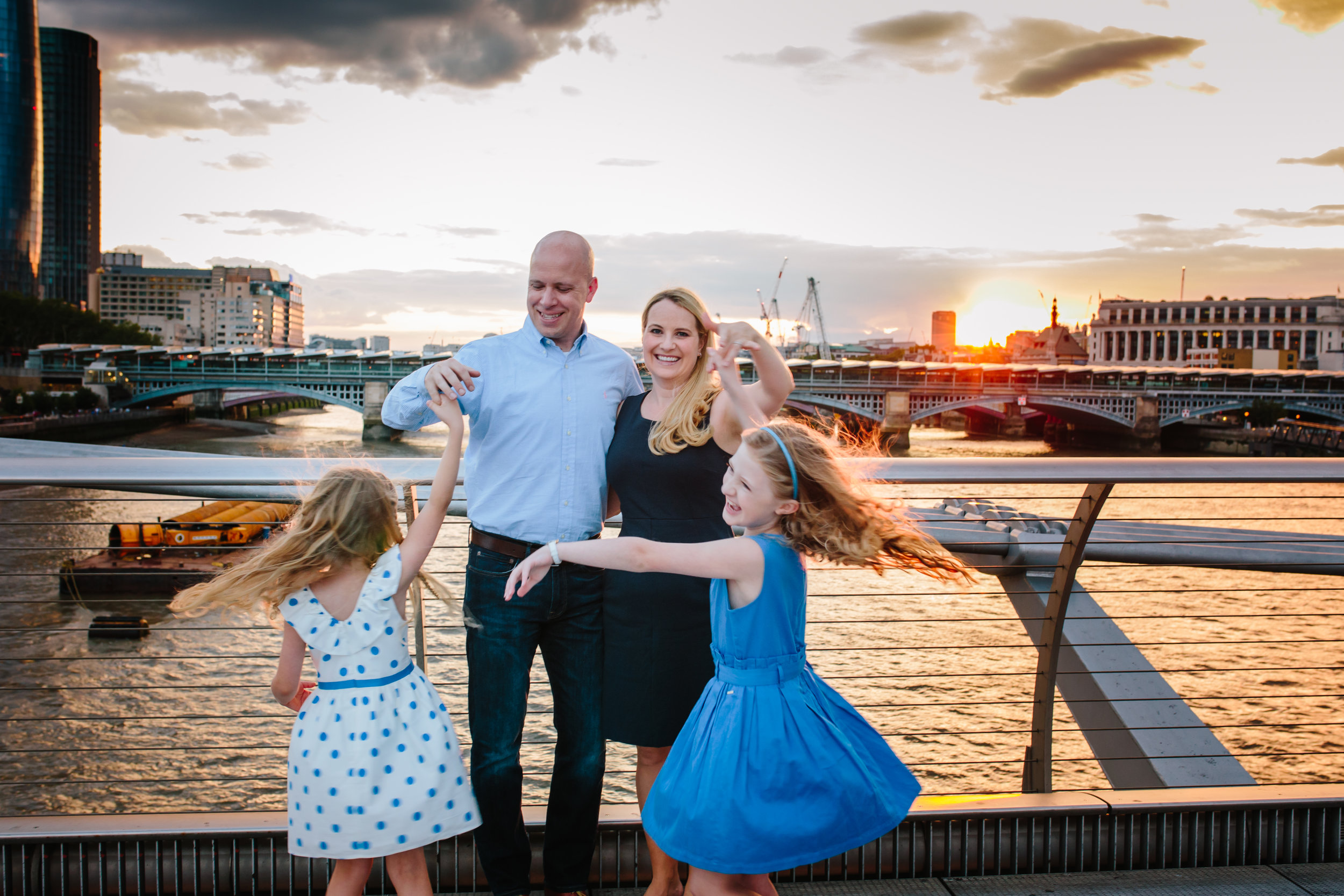 Family on Millennium Bridge in London