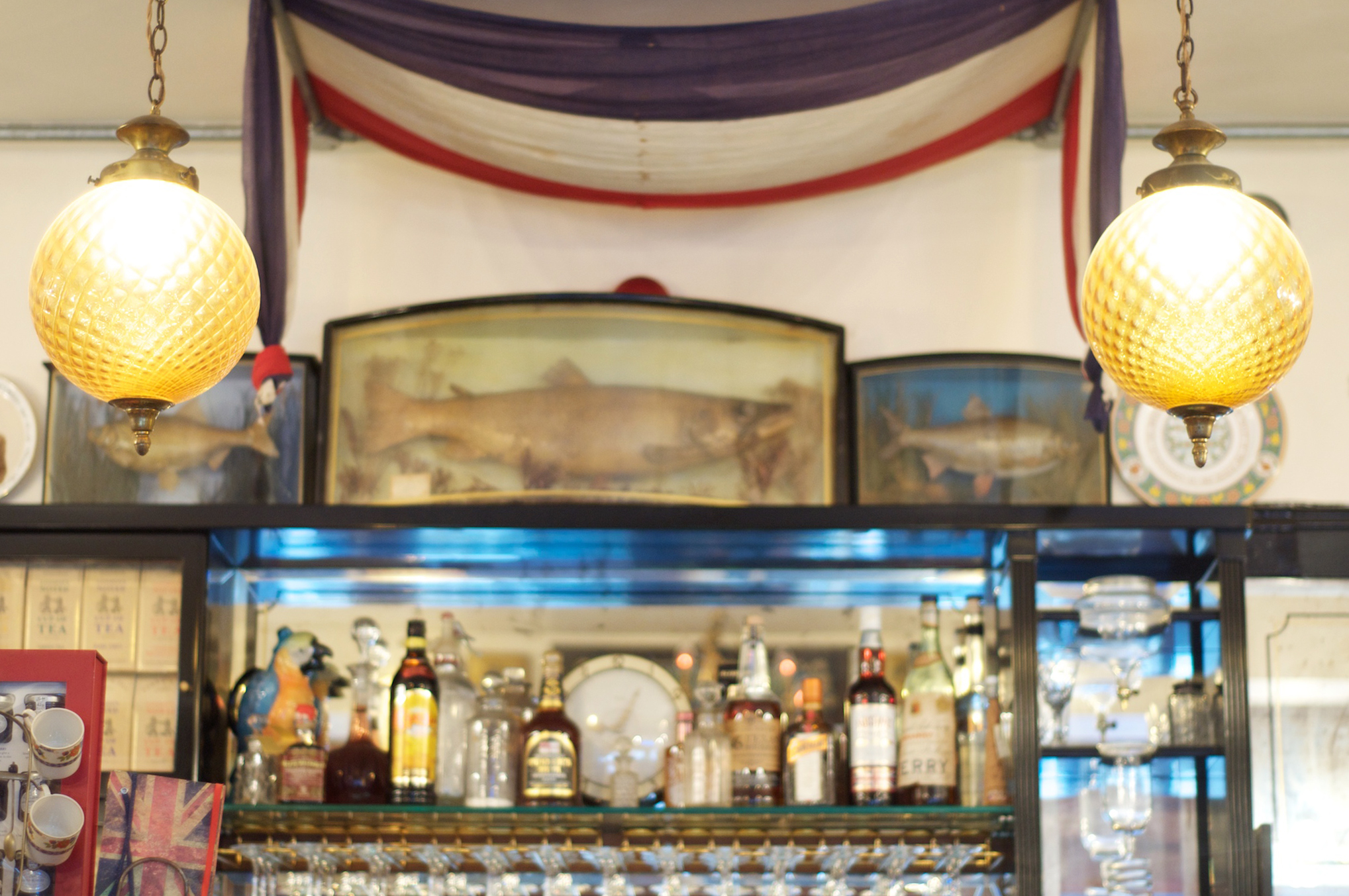 The dreamscape at Terry's: prize fish,a ceramic parrot and a French flag