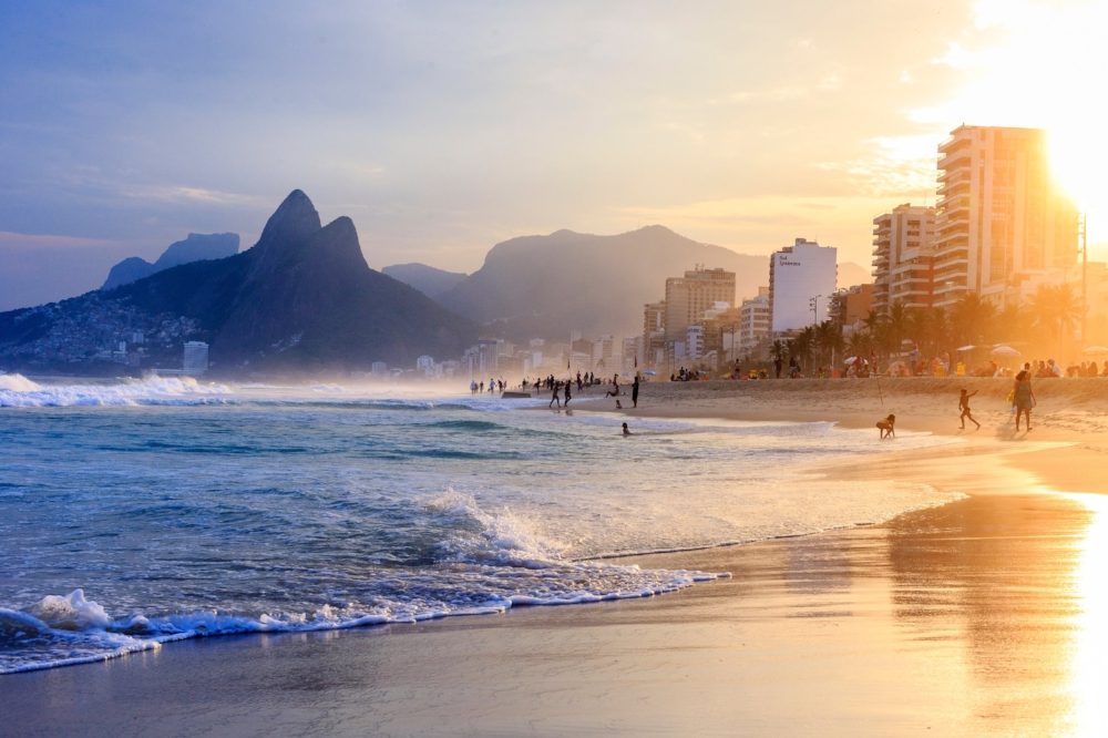 Ipanema Sunset - the Images that started this collection. Notice the left side of the image, where the favela lays on top of the mountain, being cast by a blue shade while the right hand side shows one of the most iconic and expensive places in Rio de Janeiro.