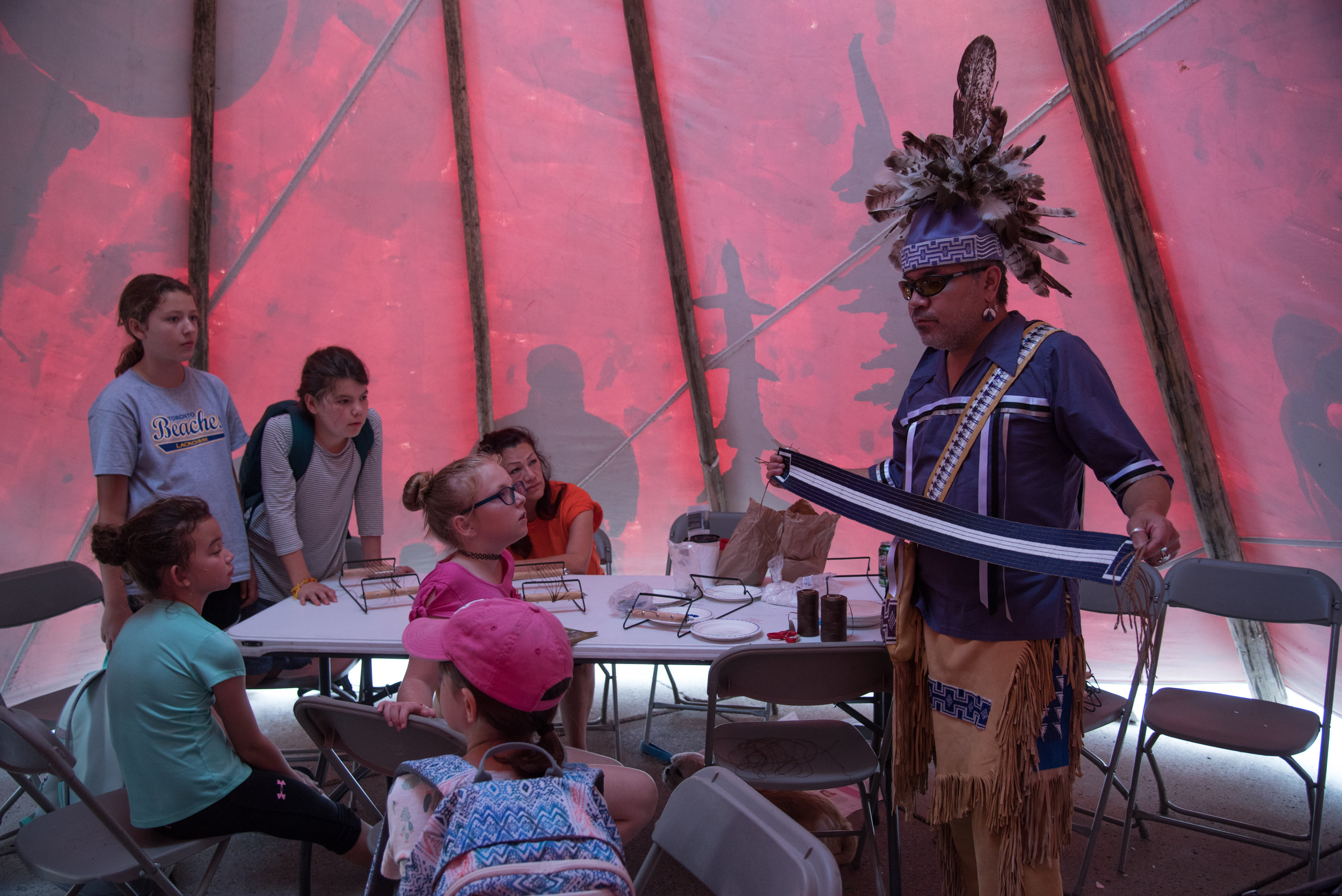 George Kennedy teaching school children about the history and stories of Wampum Belt Treaties in ANDPVA's tipi at the IRSS Legacy Event (https://irsslegacy.com)