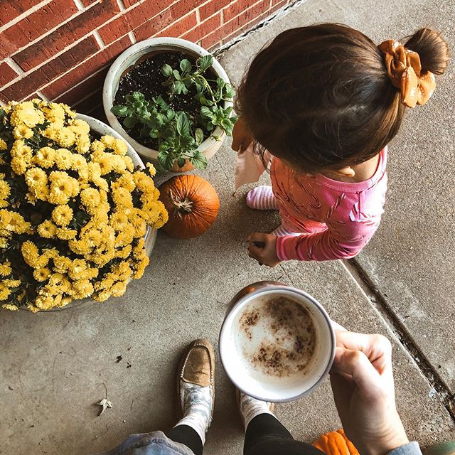 Fuzzy socks, scrunchies, and Christmas jammies with my girl ✨ tbh, i had to bribe her with halloween candy to come outside and take this picture 😂⠀ .⠀ I also just posted a latte recipe on my stories! It's the perfect holiday treat. 🎃 Happy Saturday!