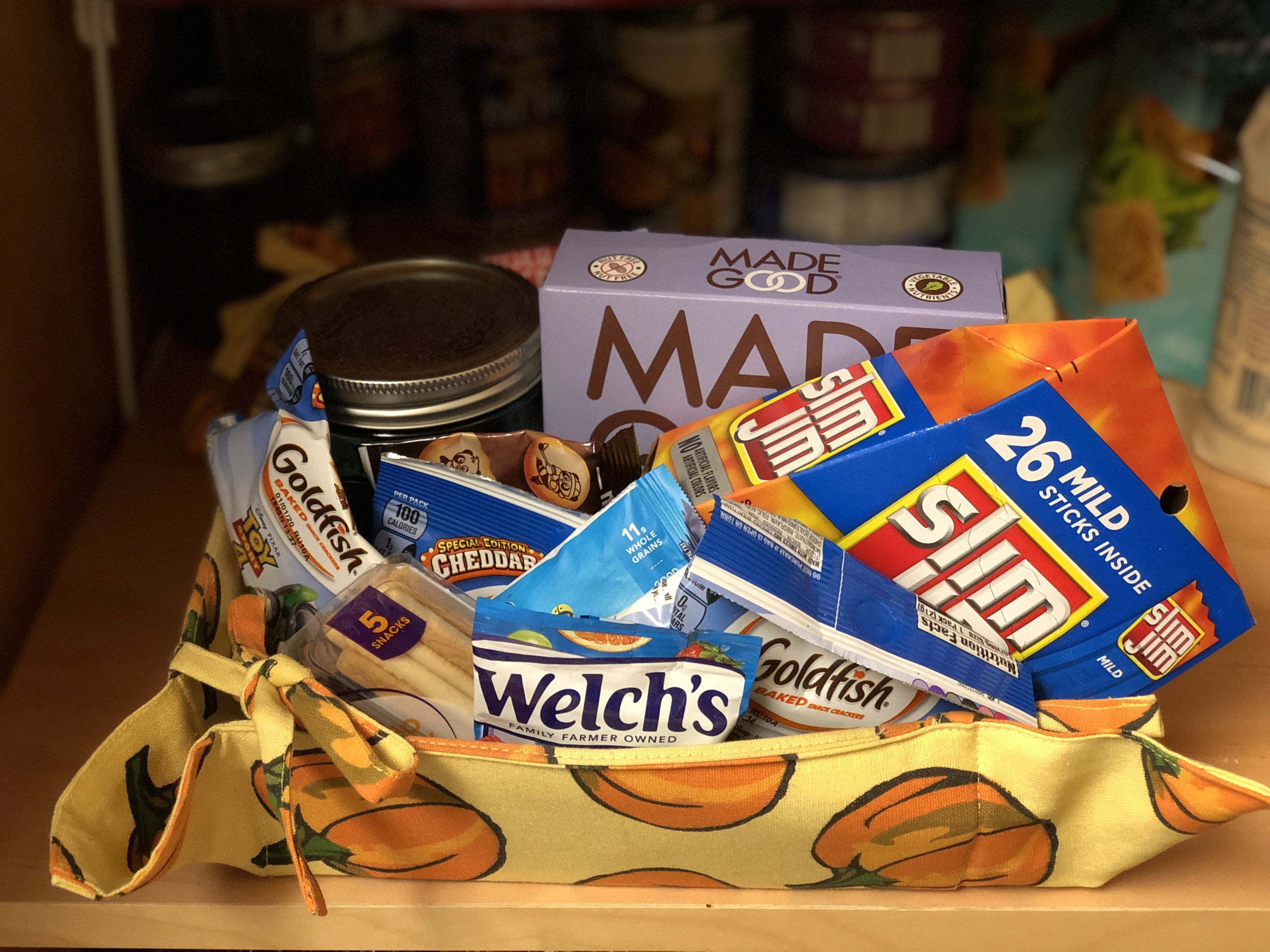 When picking snacks for this basket try to make them a single serving to help enable independence for your older child - they might need your help to open it but can otherwise do everything else, to include throw the wrapper out! Avoid snacks that can become messy like chocolate, to keep this as a snack to reduce parental involvement.