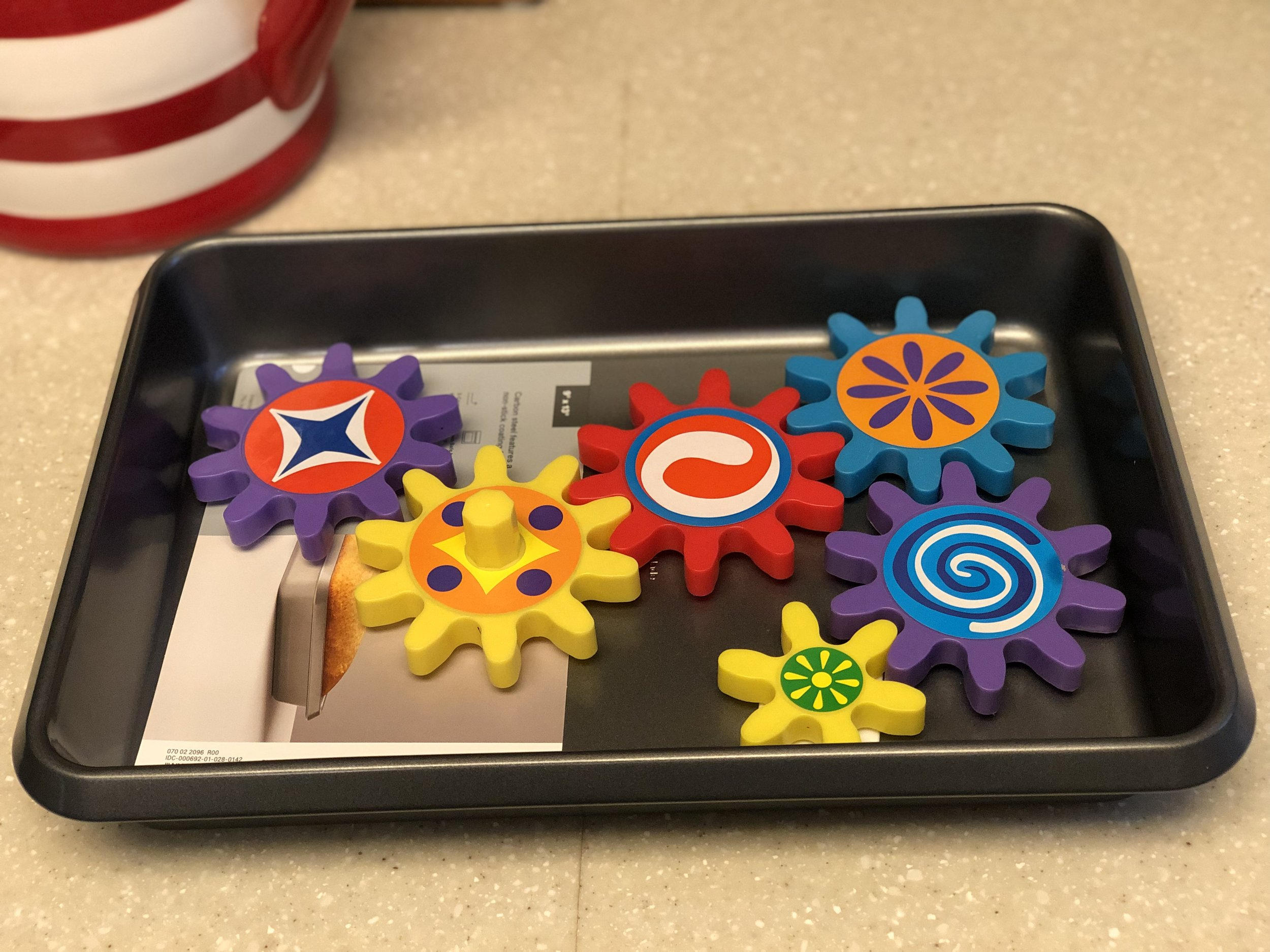 This is a cake pan with a few of the magnetic gears in them. Super fun and easy for kids to do with minimal mess. Also, parenting hack here, this is great for doctors offices, car rides, and airplanes too!