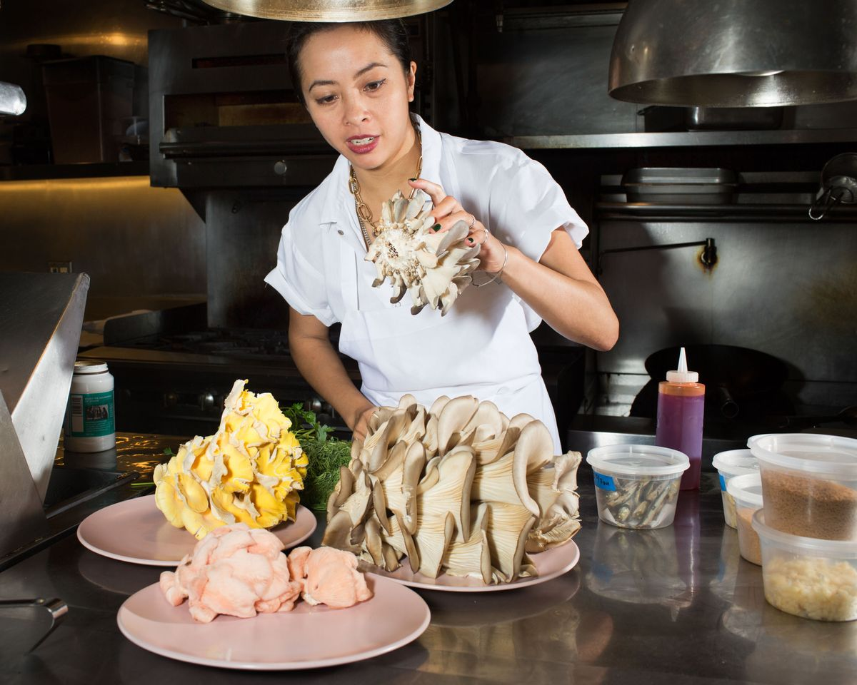 Mission's executive chef, Angela Dimayuga, cooks with varieties of oyster mushrooms grown in the Minifarm. (Photographer: Adrienne Grunwald for Bloomberg)
