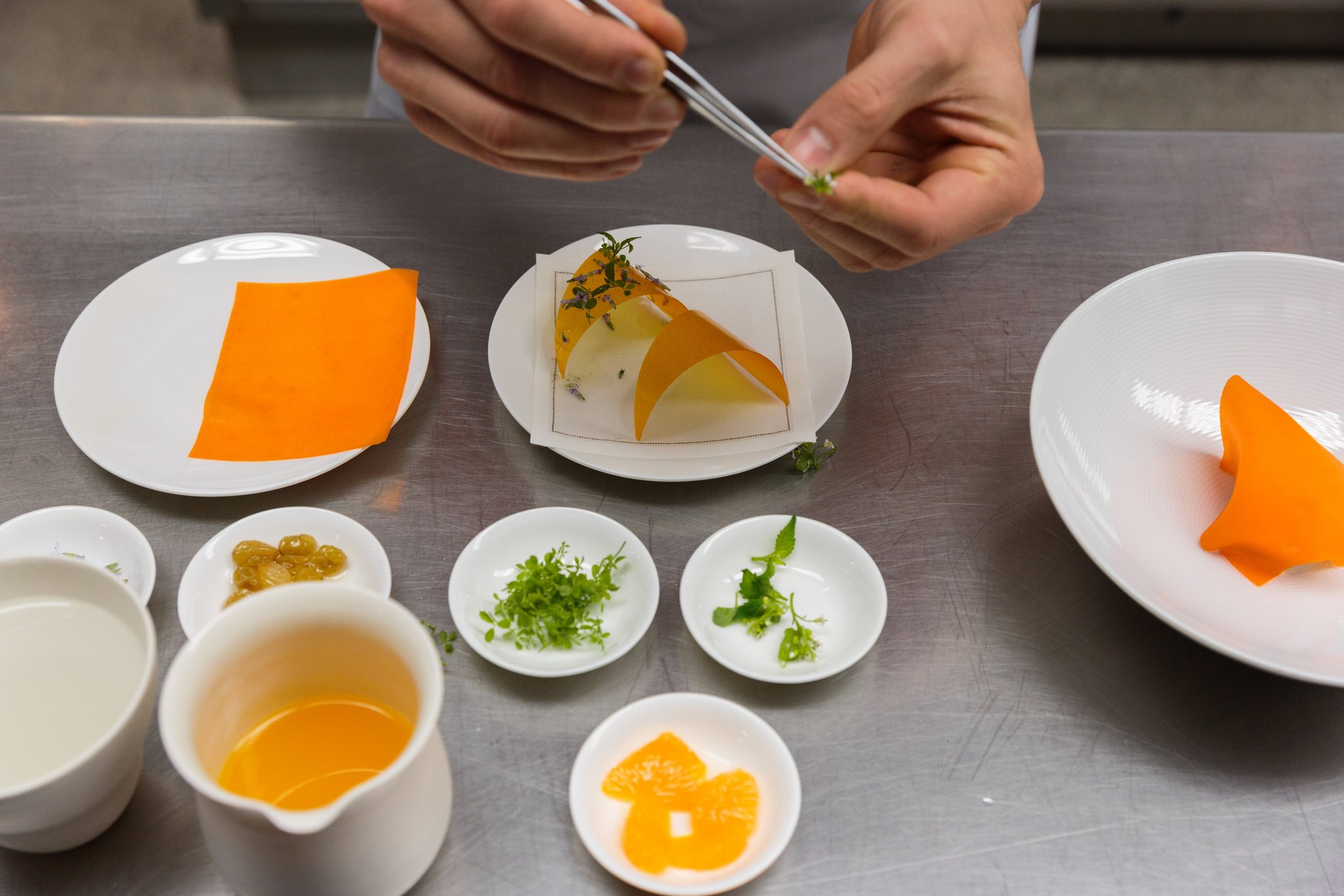 At  Atera , a restaurant housed in the same building as Farm.One, there is a course in which the chef, tableside, dresses a dish with the herbs sourced from the basement.