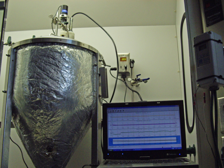An anaerobic bioreactor is used as the first stage in a two-stage process toward organic ammonium nitrate production by breaking down protein-bound nitrogen to ammonia with hyper-ammonia-producing bacteria.