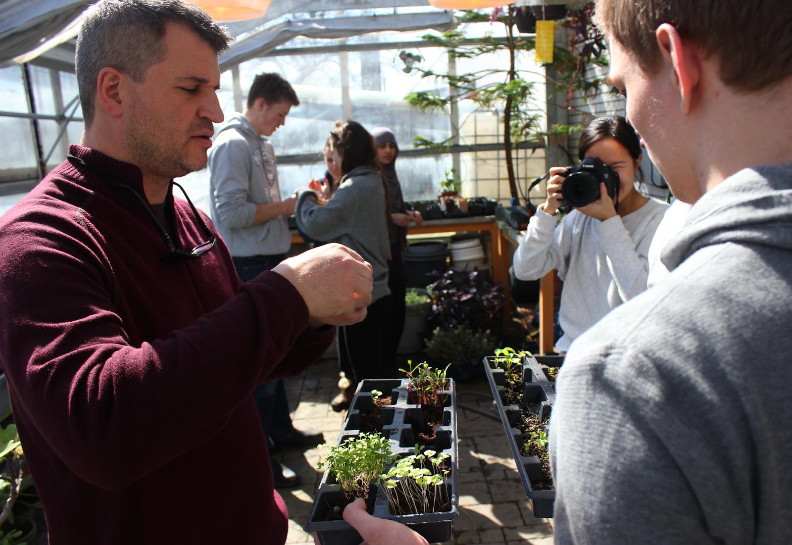 Dan Kunanec (left), inside a greenhouse at the Don Mills Collegiate Institute in Toronto, Canada.