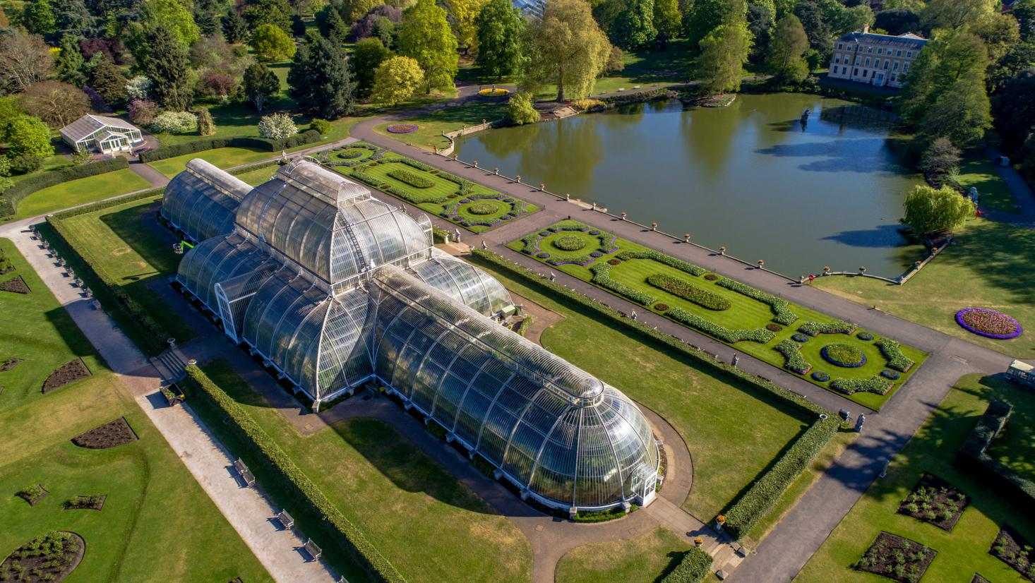 The Palm House  at Kew Royal Botanic Gardens in England, originally constructed in 1844 as a home for exotic plant varieties brought back from abroad. | Source:  itinari