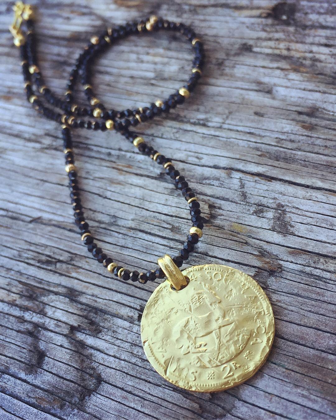 verena-strigler-gold-coin-black-spinel-krugerrand-vancouver.jpg