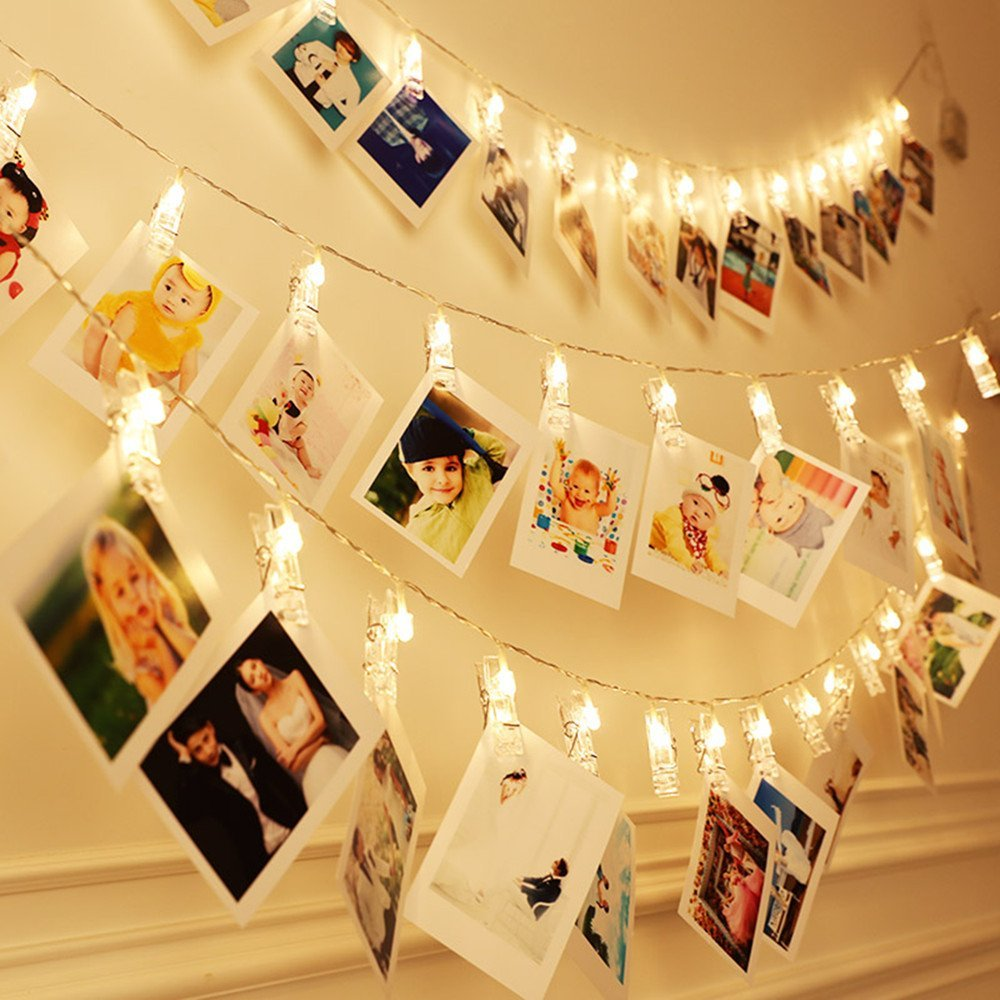 Light up your life! These fairy lights are ideal for hanging photos, holiday cards, children's artwork, or whatever lightweight crafty/decorative items you desire. - $