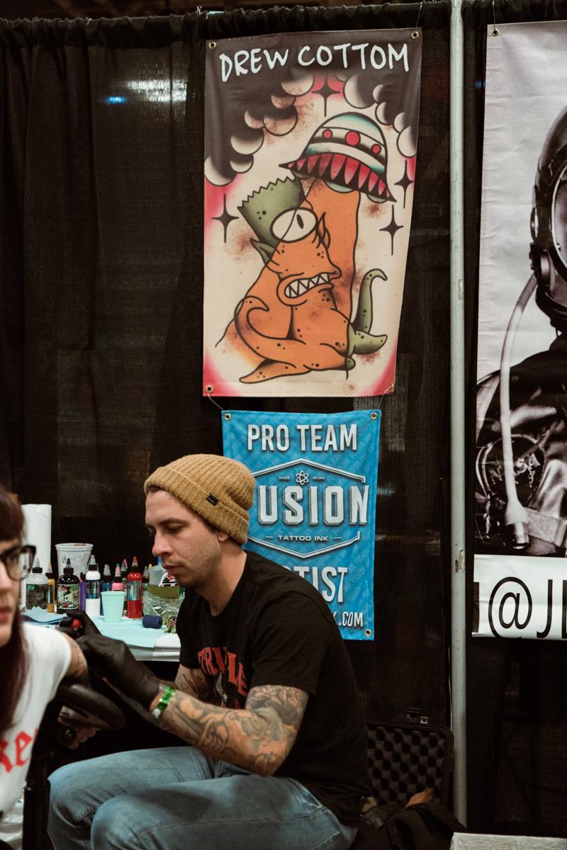 Another Amillion Tattoo artist Drew Cottom