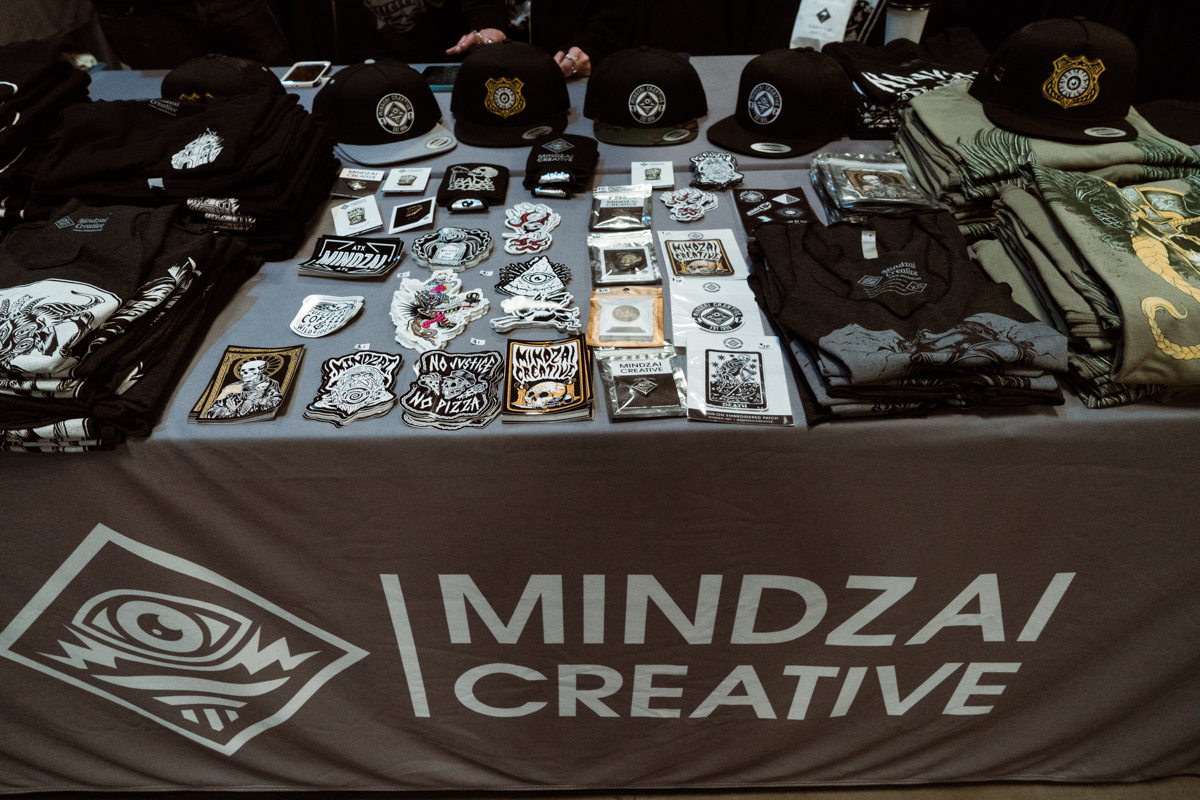 Mindzai Creative never misses a convention! This design & print shop located in Austin tackles everything from pins,stickers, prints, screen printing and more. Go see them for all your printing needs.