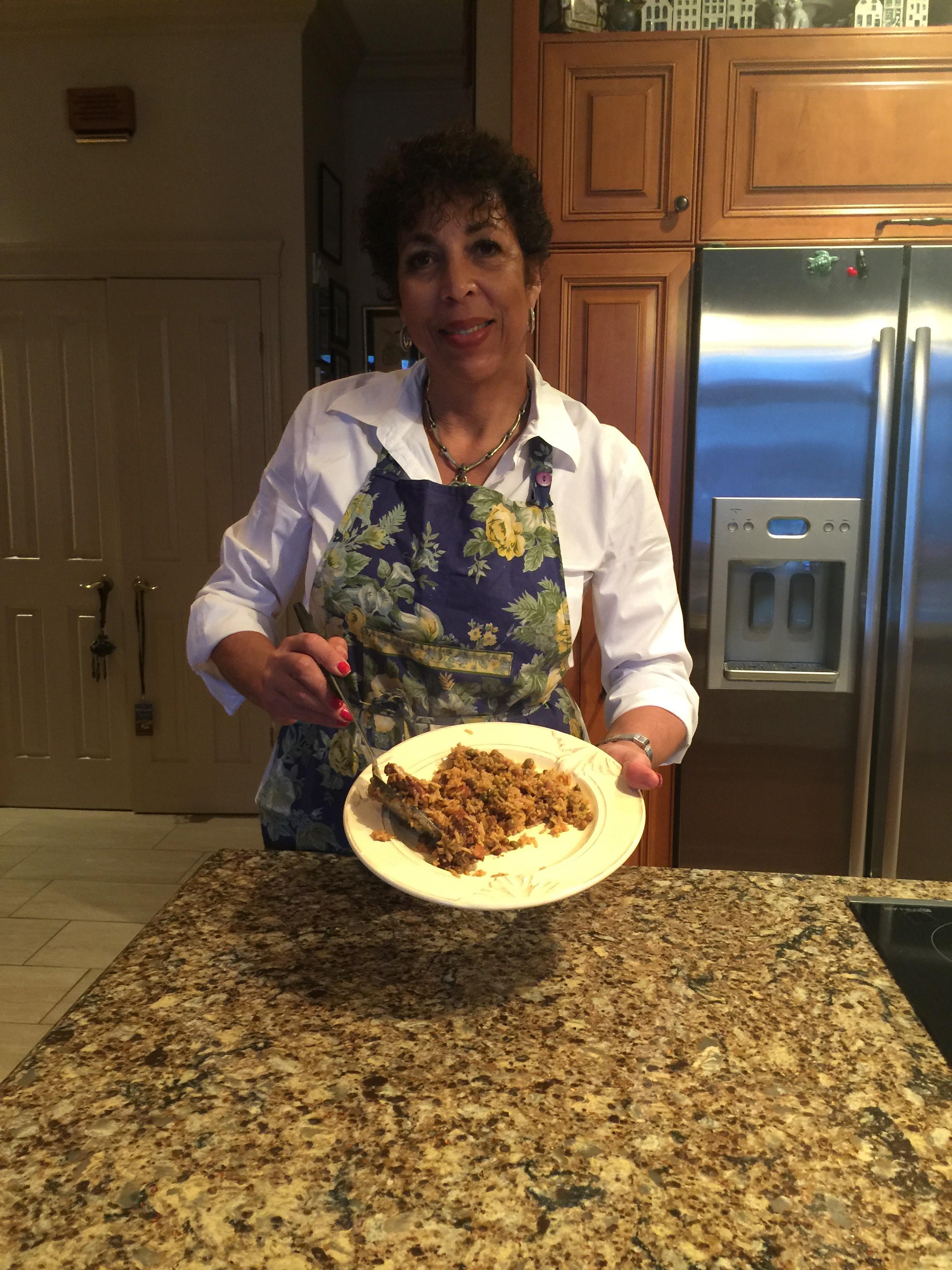 Inga Crooke Lawson in her Vaudreuil-Dorion kitchen serves up Trinidad Pelau