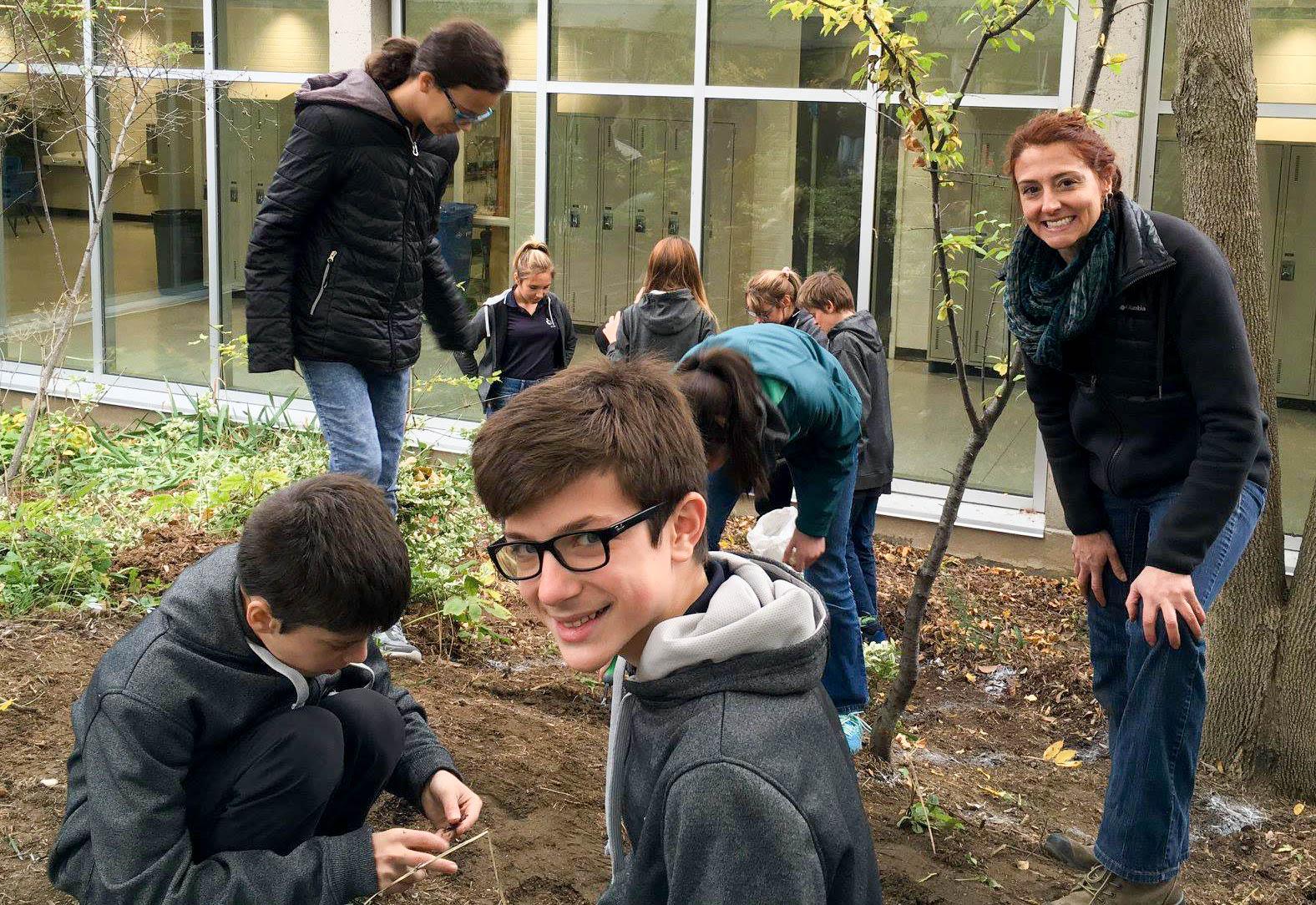 Katryne and ESCJ Students Planting Bulbs.jpg